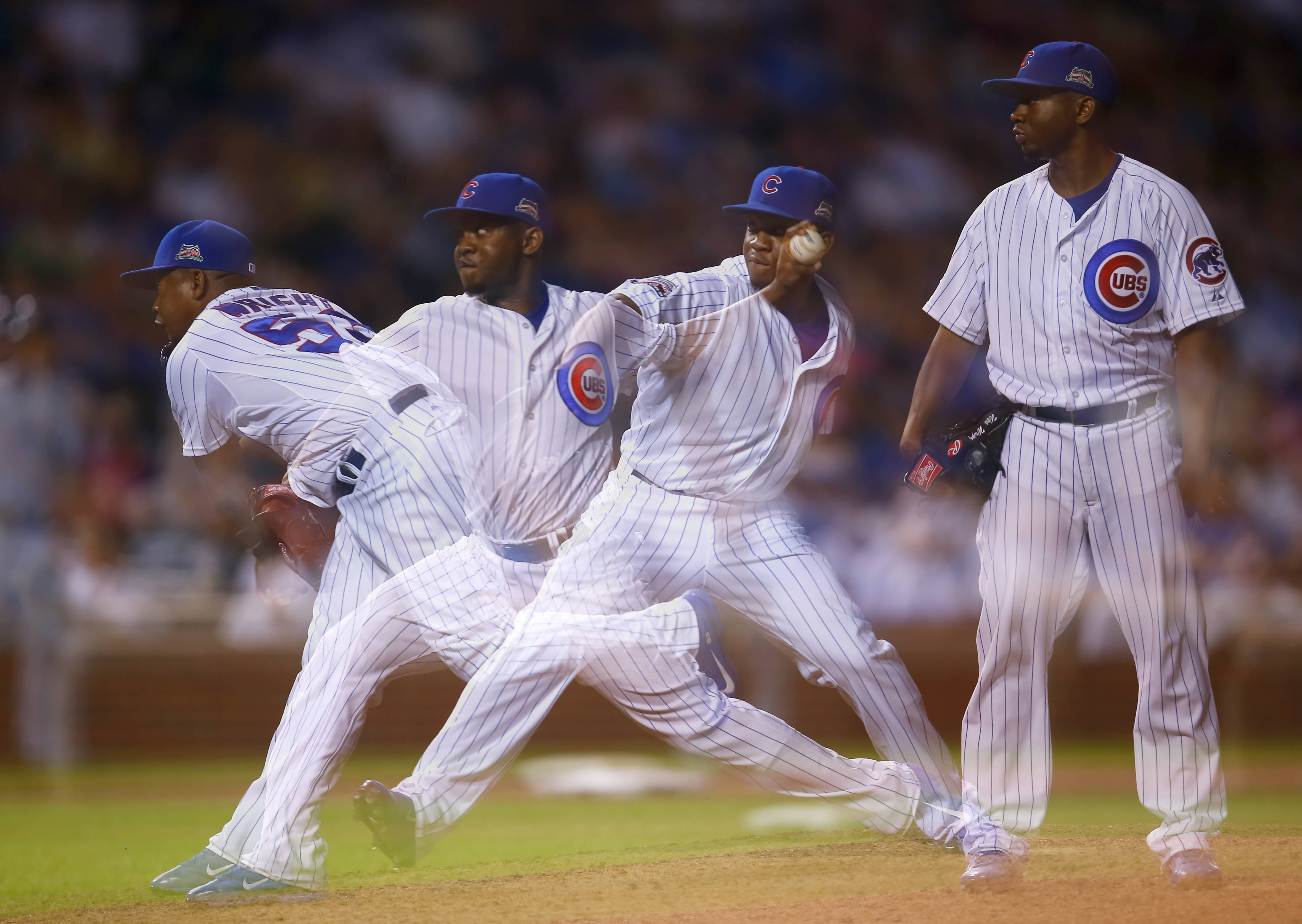 In this multiple exposure photo Chicago Cubs relief pitcher Wesley Wright (53) delivers a pitch against the San Diego Padres during the ninth inning of a baseball game in Chicago, Tuesday, July 22, 2014. The Cubs won the game 6-0.