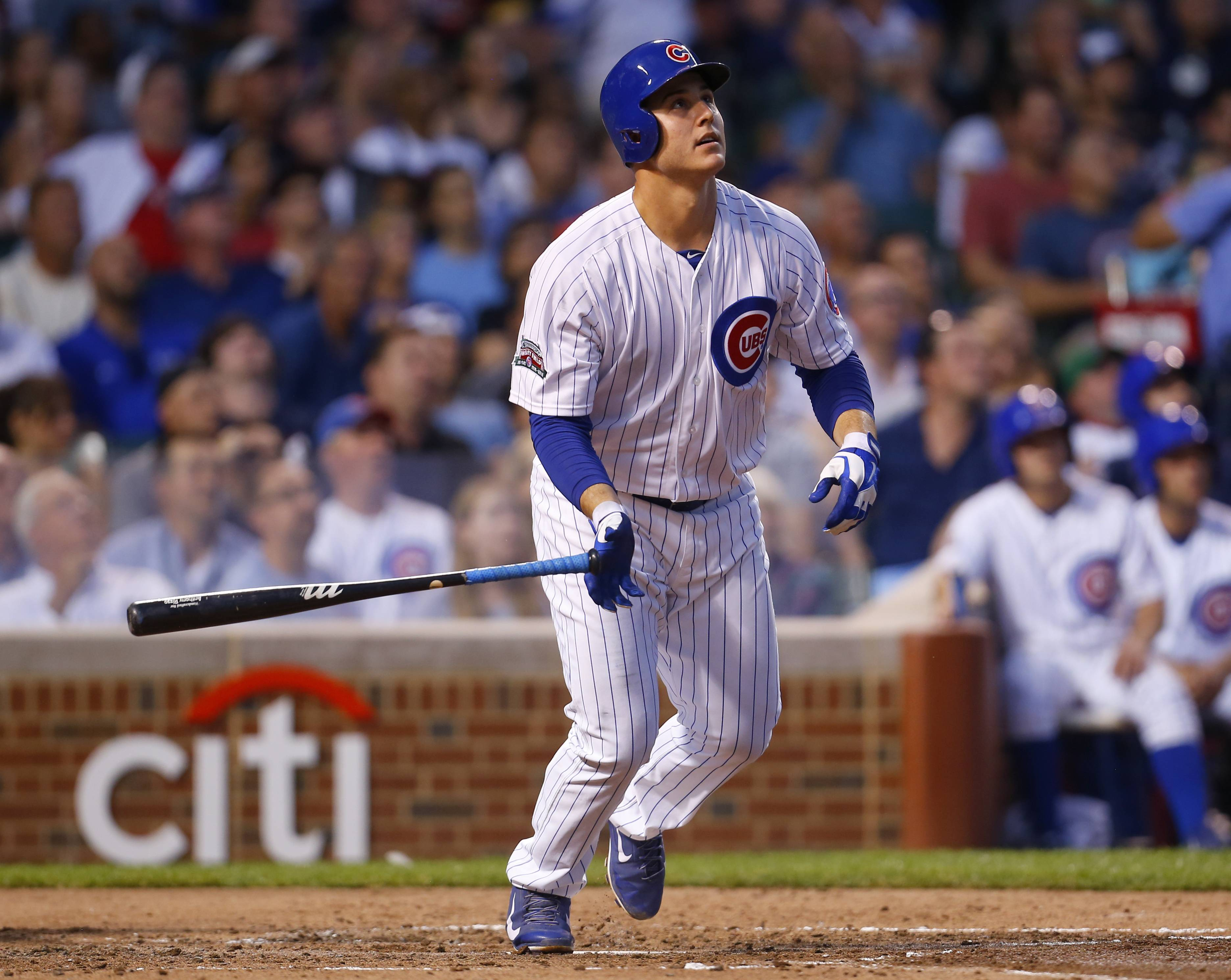Chicago Cubs first baseman Anthony Rizzo (44) watches his solo home run in the third inning of a baseball game against the San Diego Padres in Chicago, Tuesday, July 22, 2014. (AP Photo/Jeff Haynes)