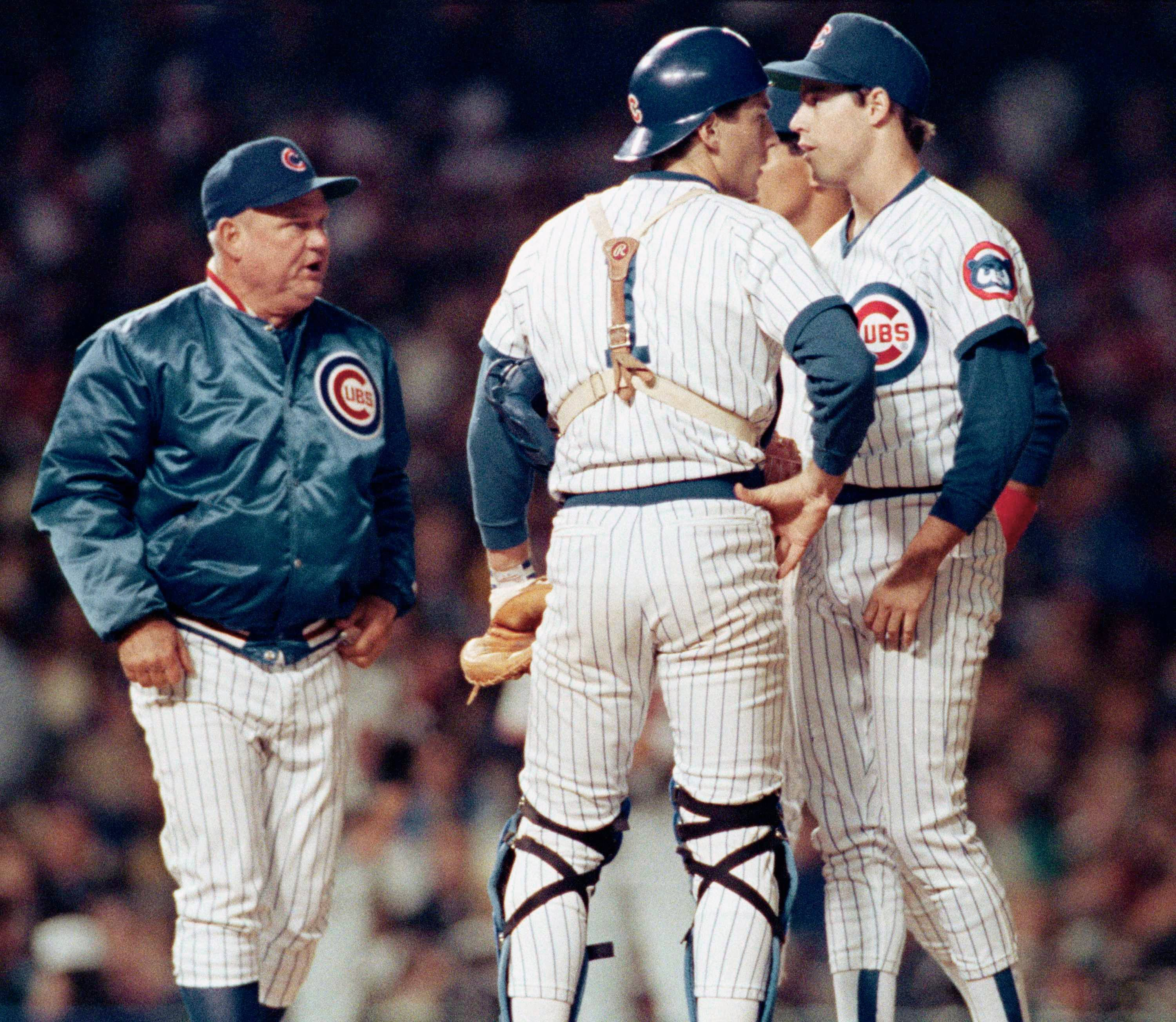 Cubs manager Don Zimmer, left, approaches pitcher Greg Maddux, right, and catcher Rick Wrona (1) with the bases loaded and San Francisco Giants Will Clark at bat during the fourth inning, Wednesday, Oct. 5, 1989. Clark hit a grand slam homer, leading the Giants to an 11-3 win over the Cubs to take the first game of the NL championship series.