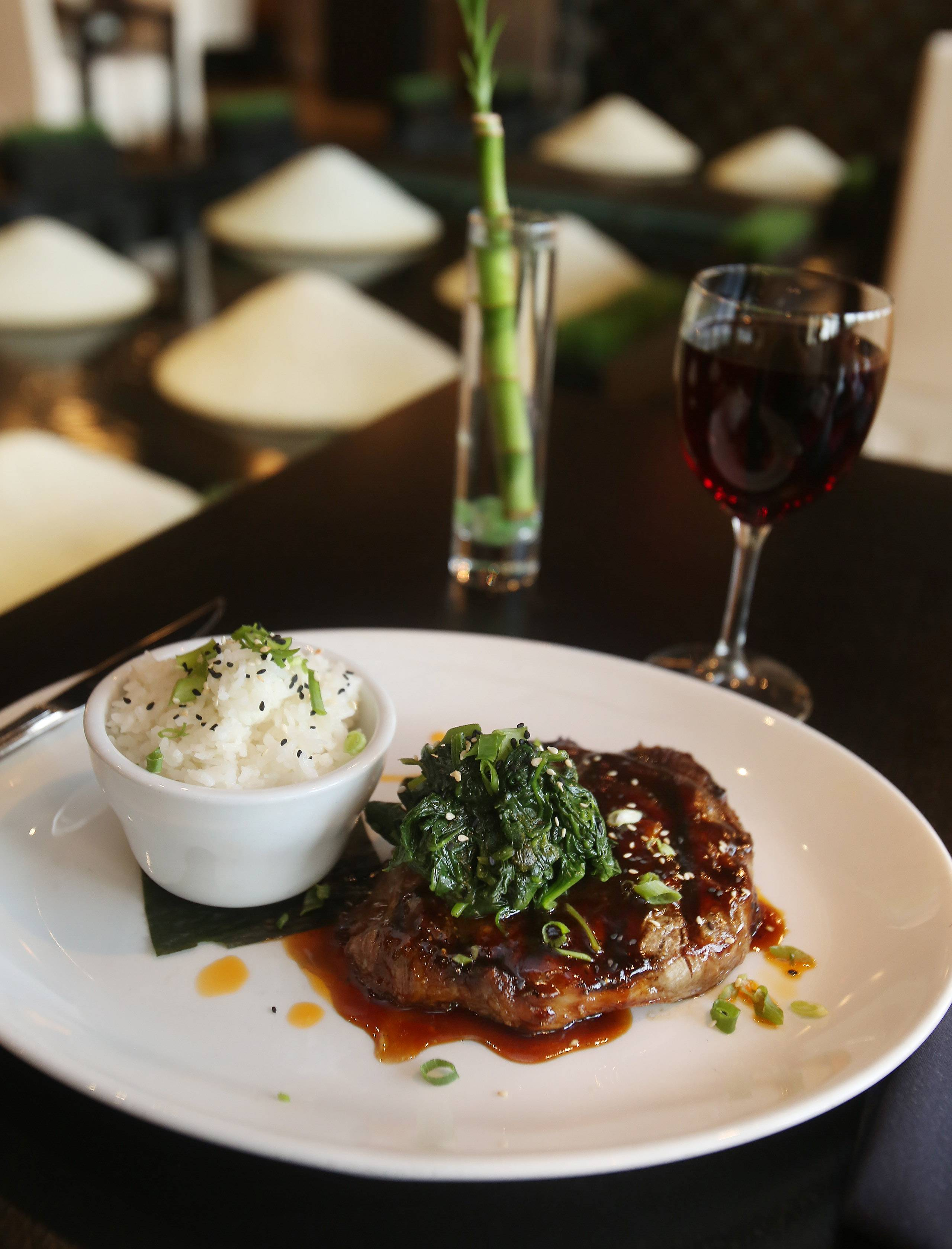 Karma's Korean barbecue-glazed rib-eye comes with sticky sesame rice and wilted ginger spinach.