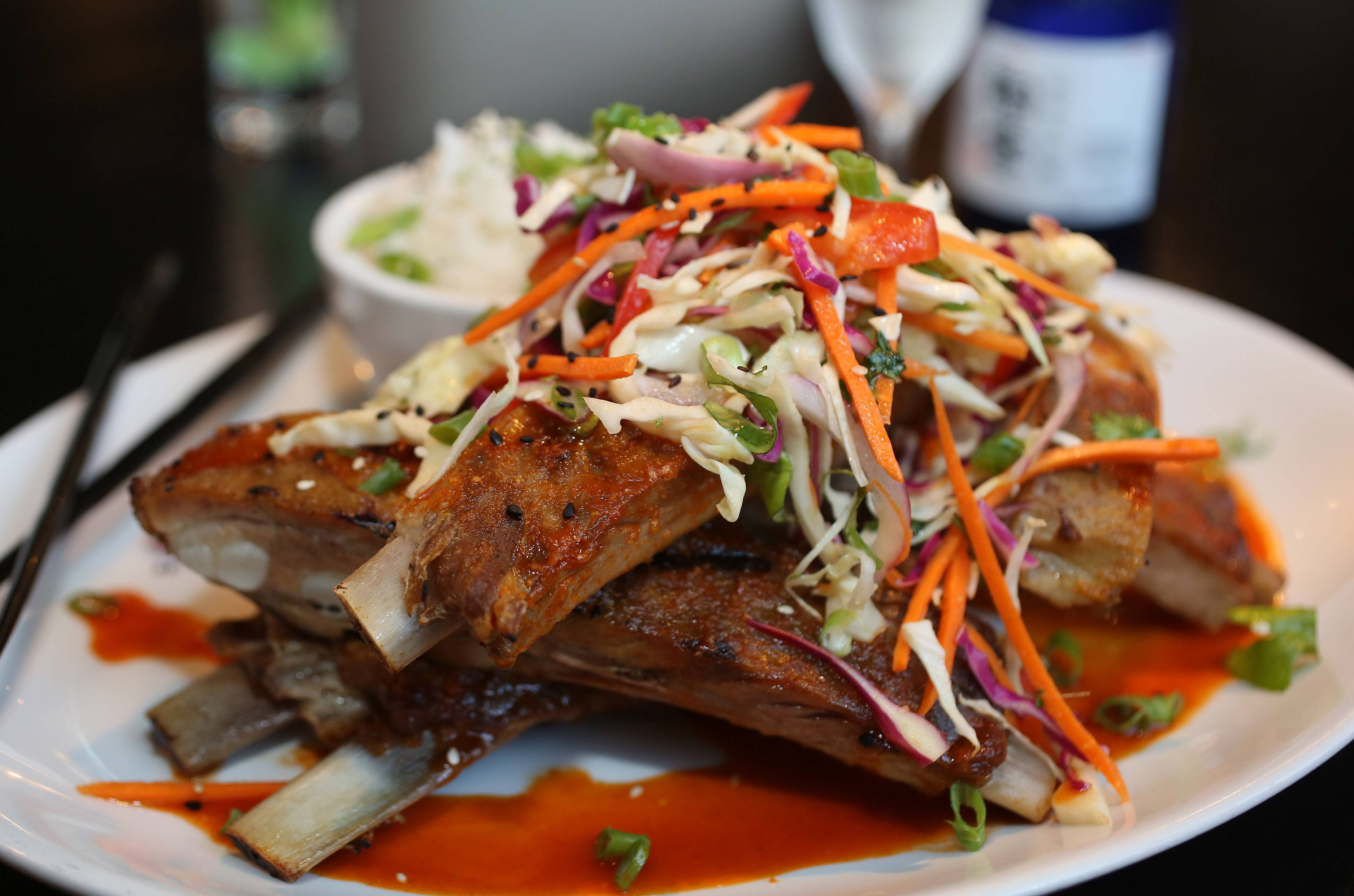Karma's ribs are accompanied by a sweet and sour slaw, scallion rice and a spicy, chili glaze.
