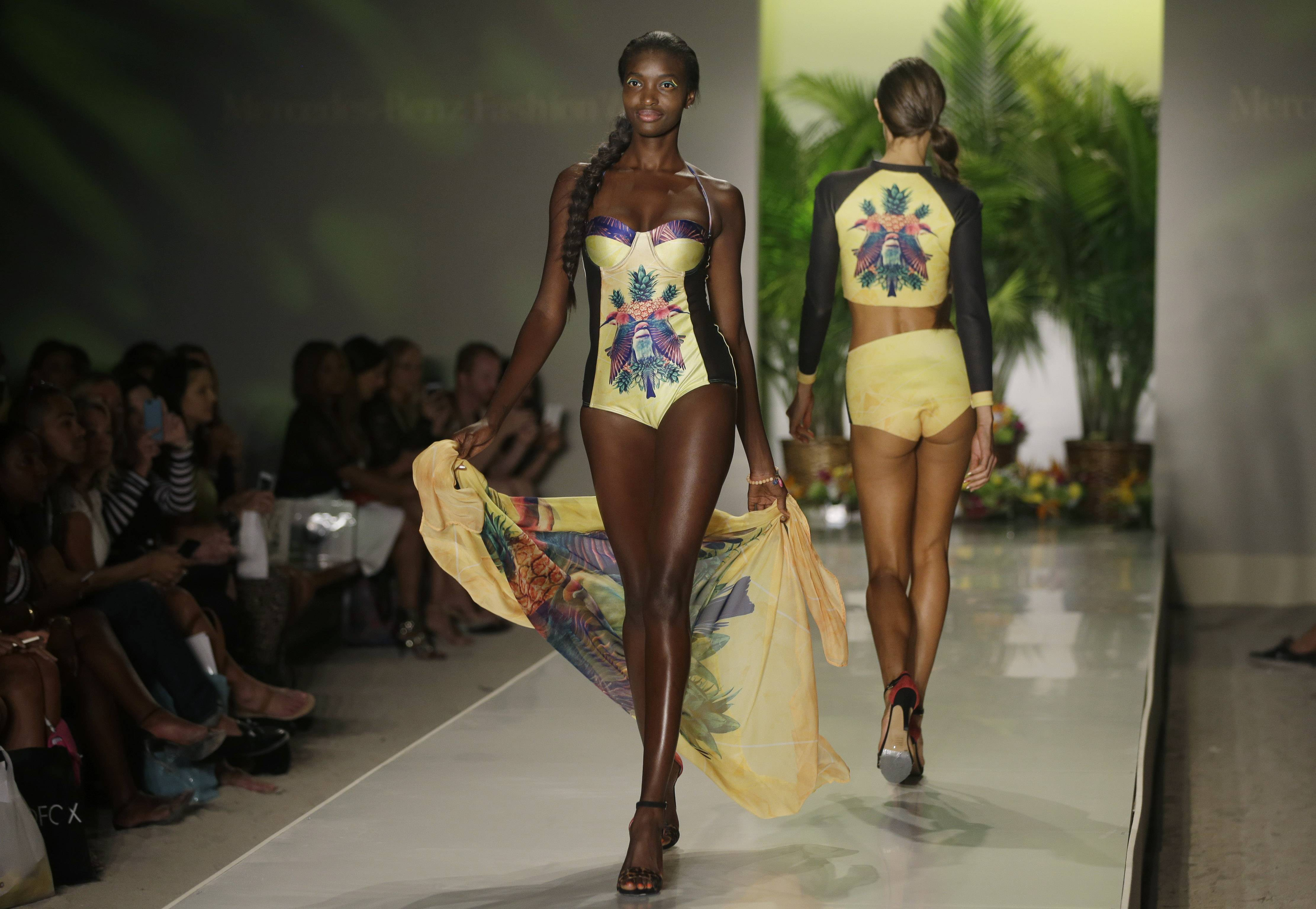 Models show off swimwear designed by We Are Handsome during the Mercedes-Benz Fashion Week Swim show Friday in Miami Beach, Fla.