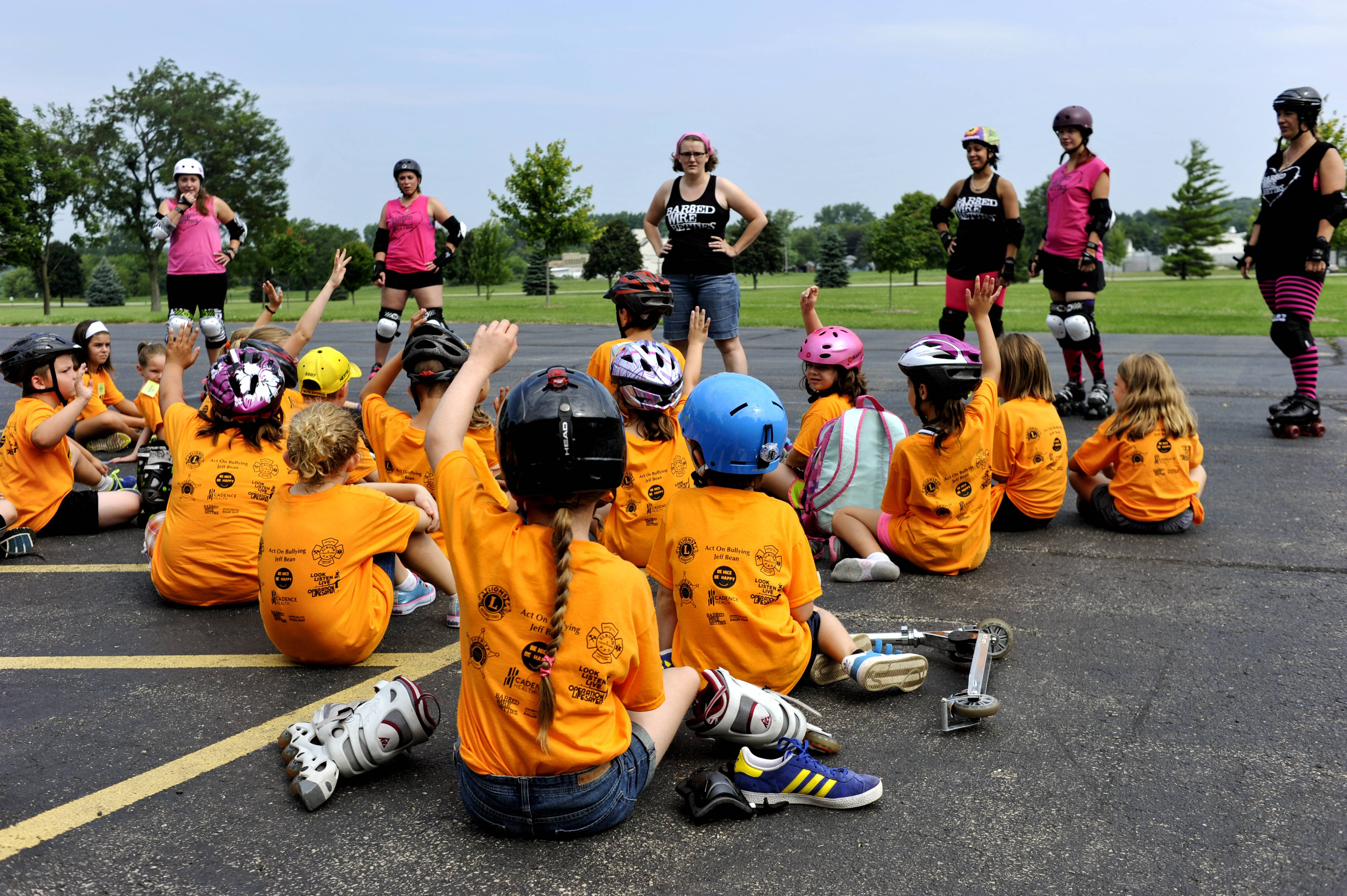 The Barbed Wire Betties, DeKalb's Roller Derby League instruct kids about skating safety during the Safety Camp for Kids at Elburn Lions Club on Tuesday. The two-day camp was free for kids ages 7-10 and taught them about how to stay safe in a variety of situations.