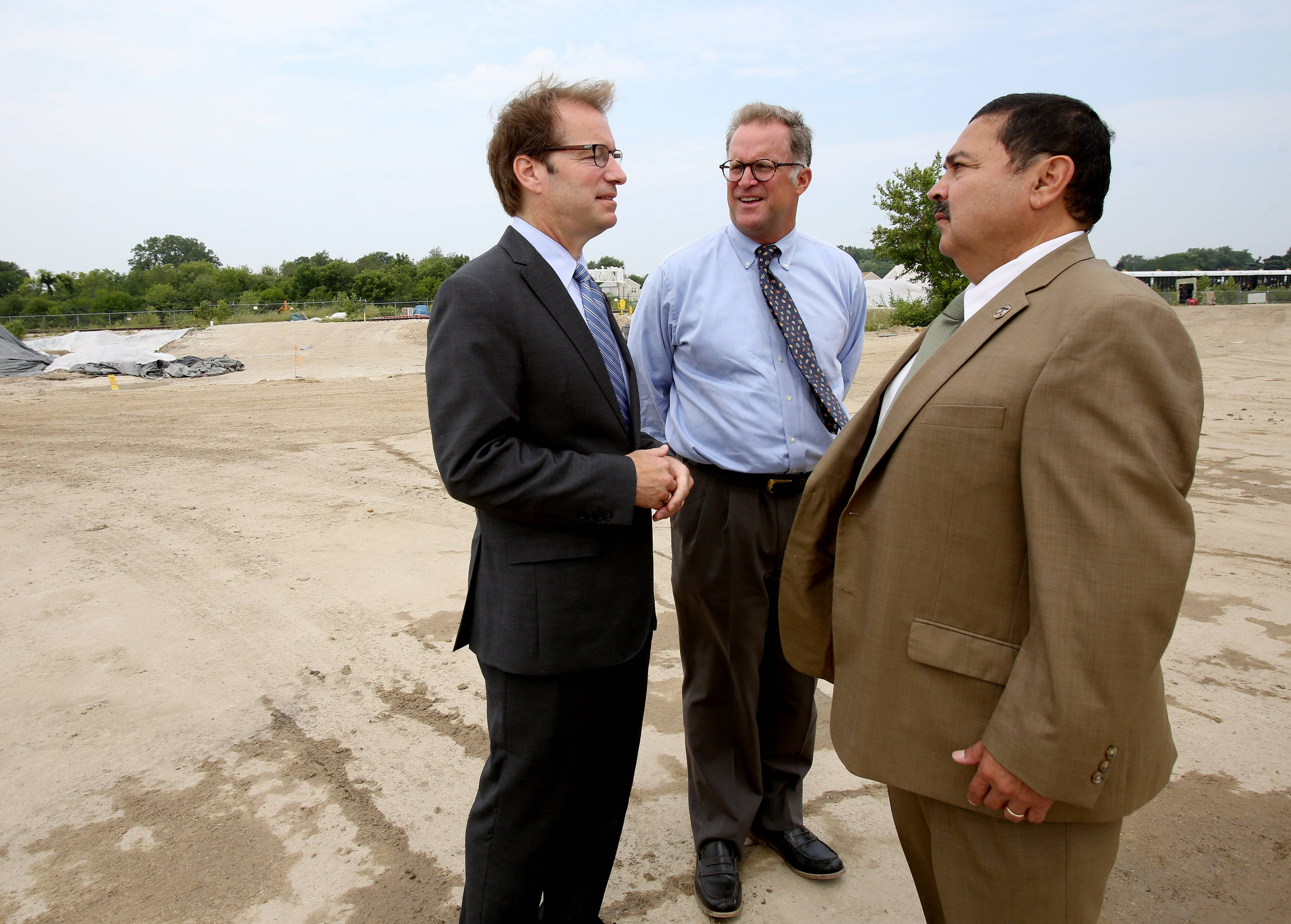 Congressman Peter Roskam joins other community leaders, including DuPage County Board Chairman Dan Cronin, center, and West Chicago Mayor Ruben Pineda to call for more federal money to finish the environmental cleanup of the former Kerr-McGee factory site in West Chicago.