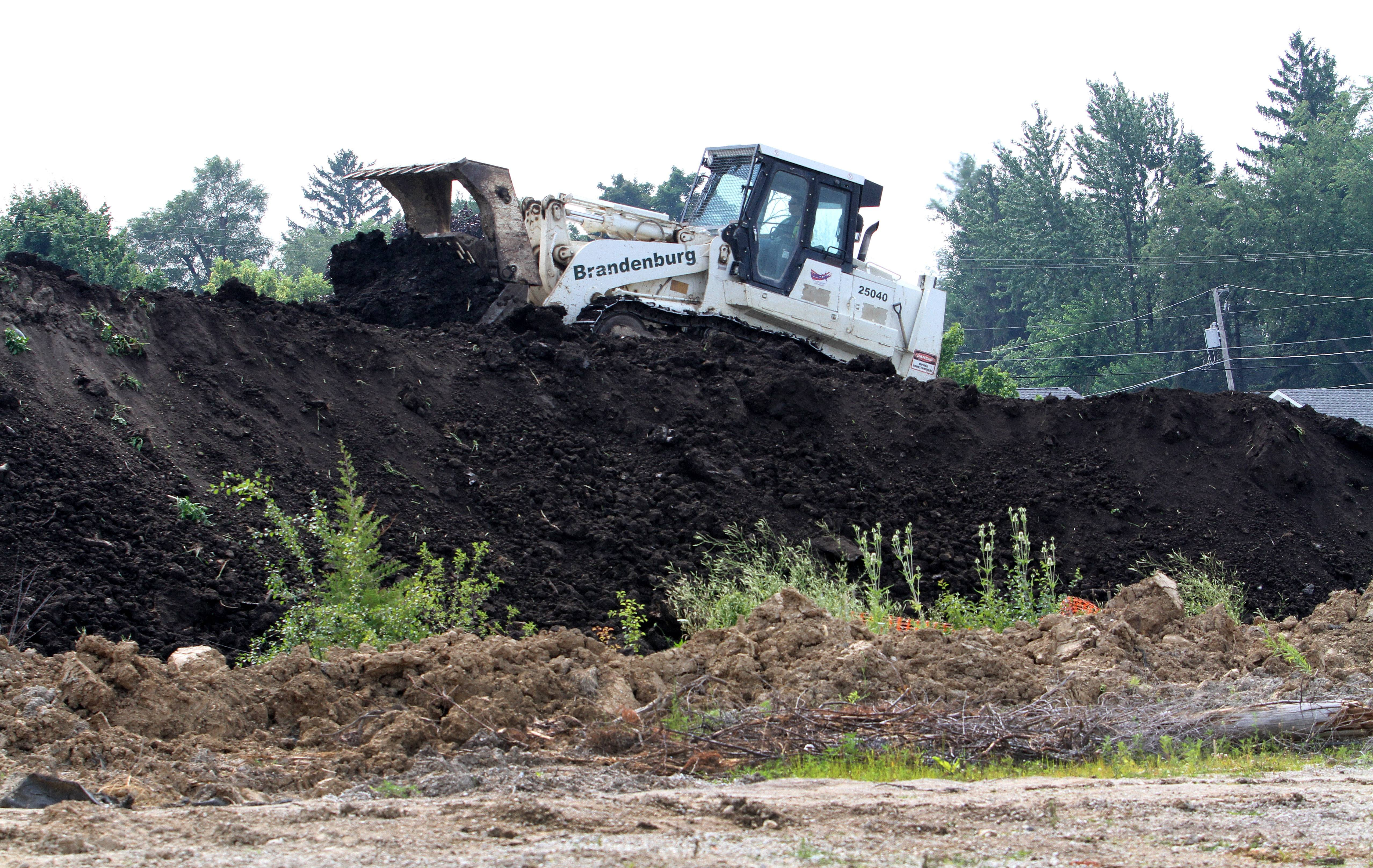 Fresh dirt is being brought into the former Kerr-McGee factory site in West Chicago. City officials are hoping the property will someday become a park.