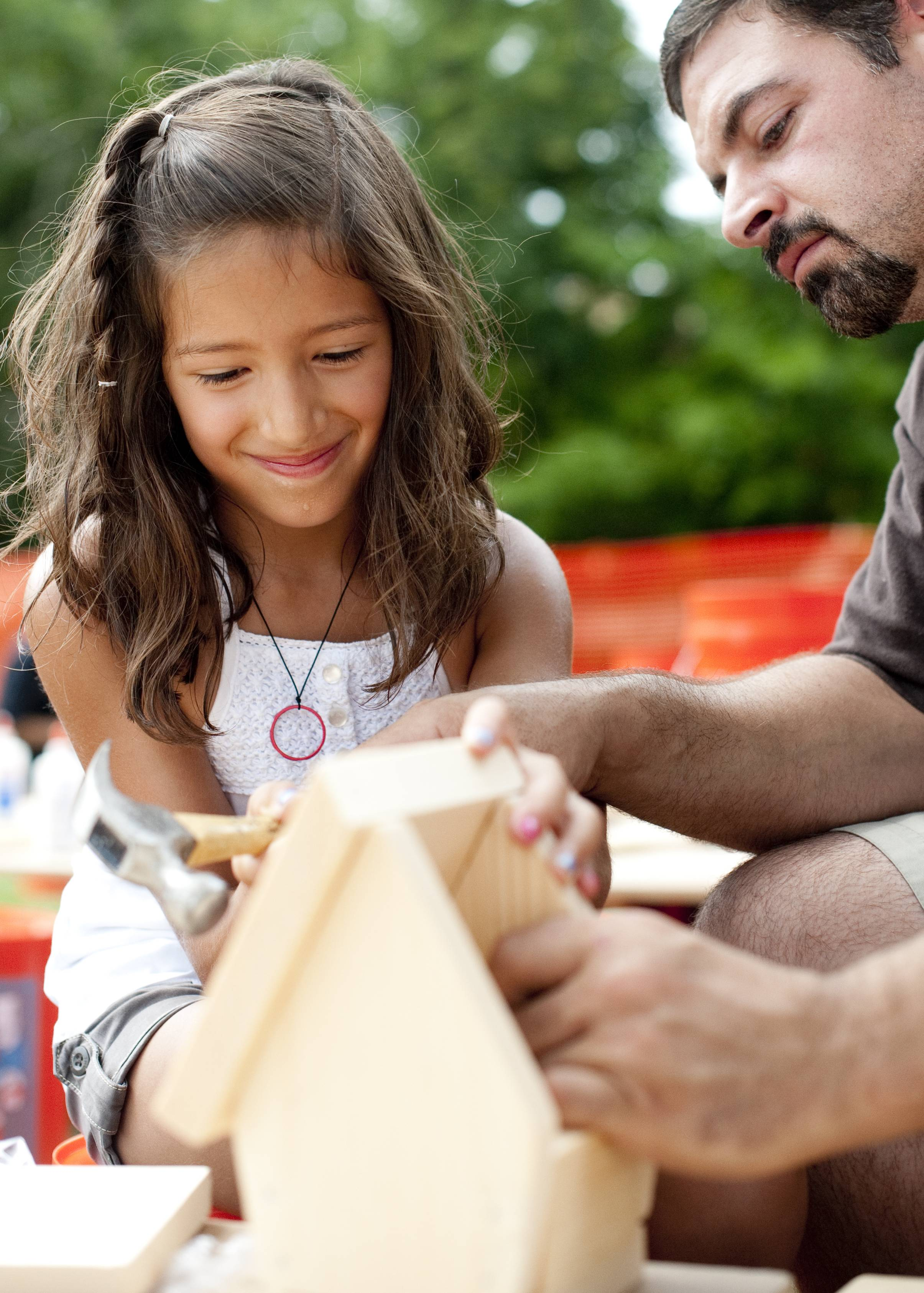 Alexis Celentano, 7, of Cary gets help from her father, David, while putting the roof on a birdhouse in the crafts area of the 52nd Algonquin Founders' Days festival.