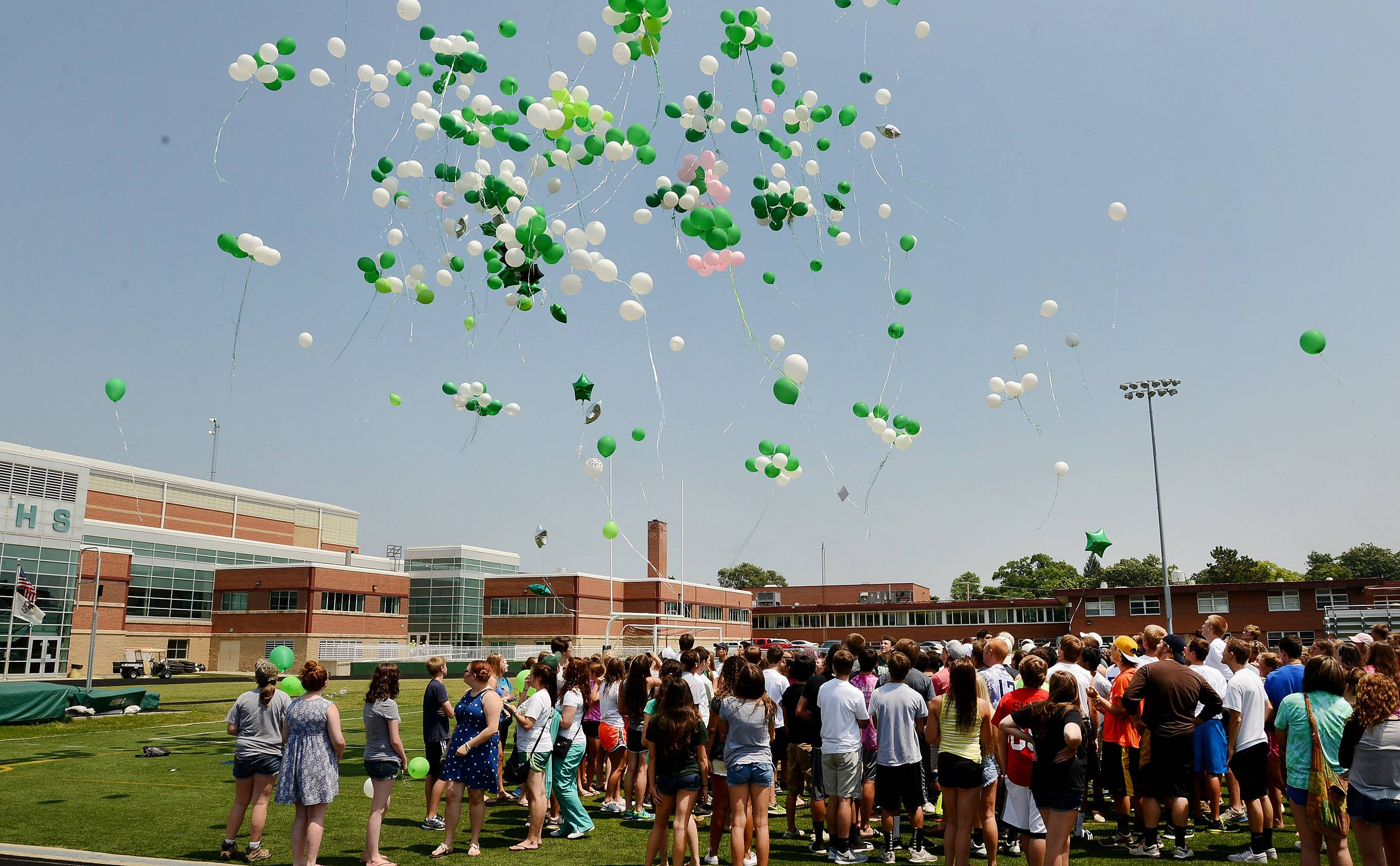 Friends of Matt Reed gathered on Grayslake Central High School's football field Tuesday to release green and white balloons -- matching the school's colors -- in his memory. Reed, a 16-year-old incoming junior, drowned Monday while swimming with friends in Third Lake.