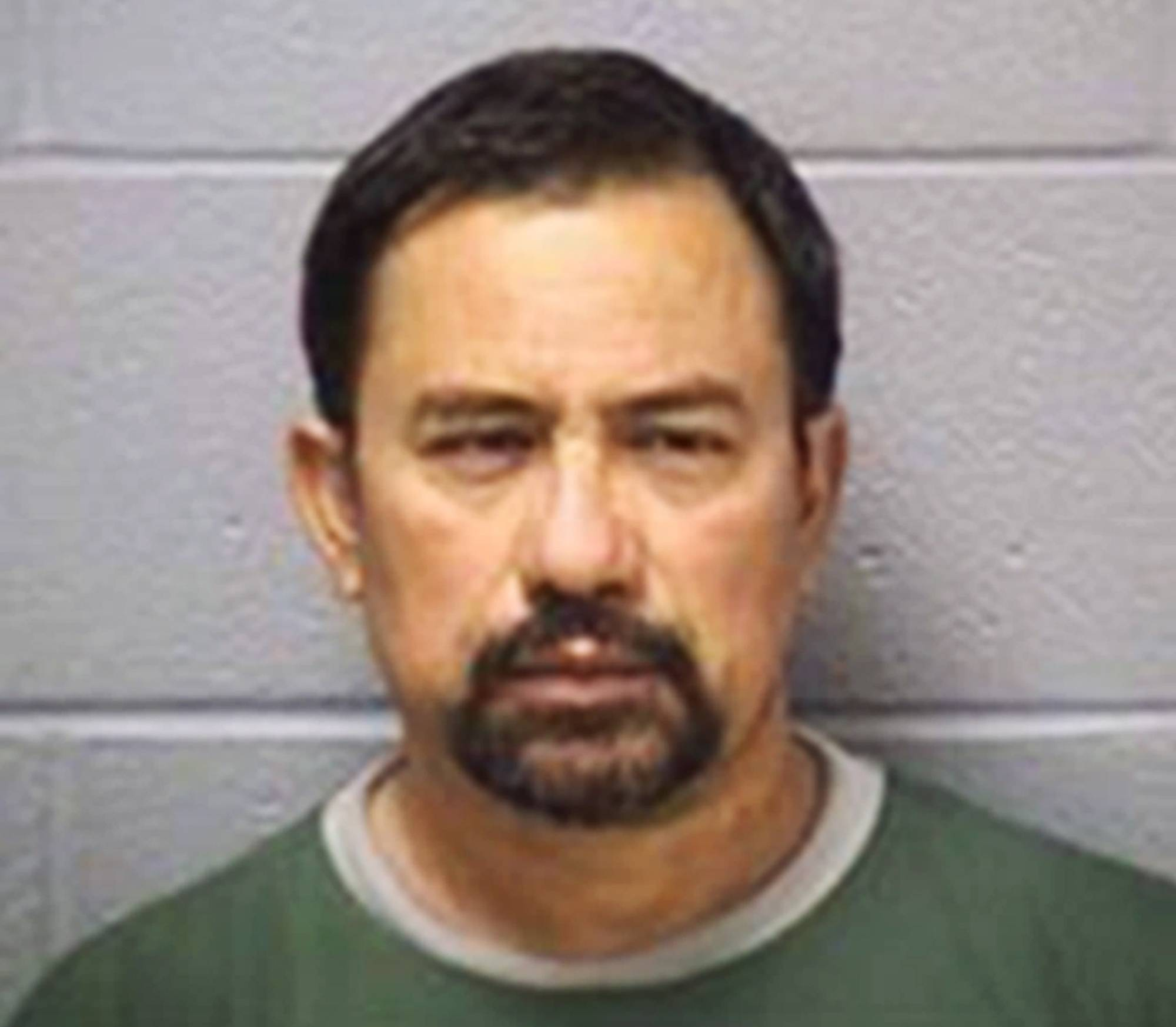 This undated photo provided by the Will County Sheriff's Department in Joliet, Ill., shows semi-truck driver Francisco Espinal Quiroz, 51, of Leesburg, Ind., who was involved in a crash Monday, July 21, 2014, on Interstate 55 that killed four people near Channahon, southwest of Chicago. Quiroz was charged with failure to reduce speed to prevent an accident and willfully making false entries in his logbook.