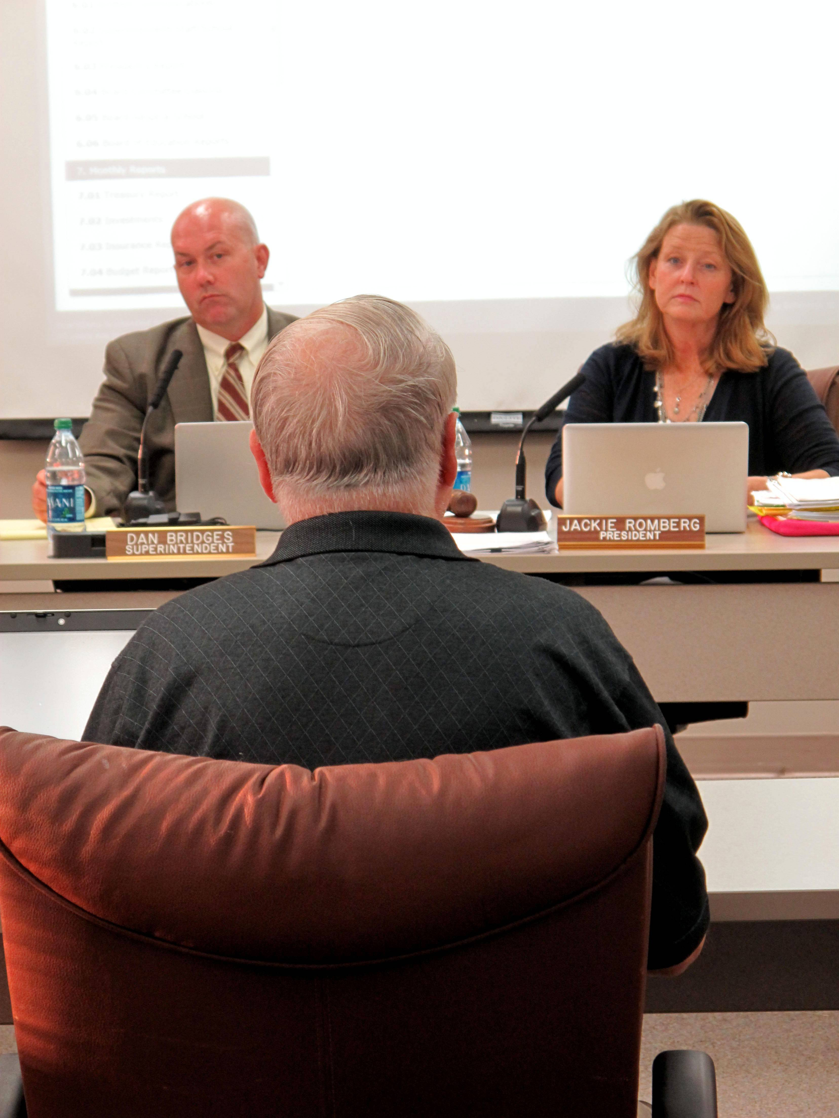 Naperville Unit District 203 Superintendent Dan Bridges and school board President Jackie Romberg listen to Naperville resident Charlie Brown explain his opposition to a proposal to allow AT&T to lease space at Kennedy and Lincoln junior highs for cell towers.