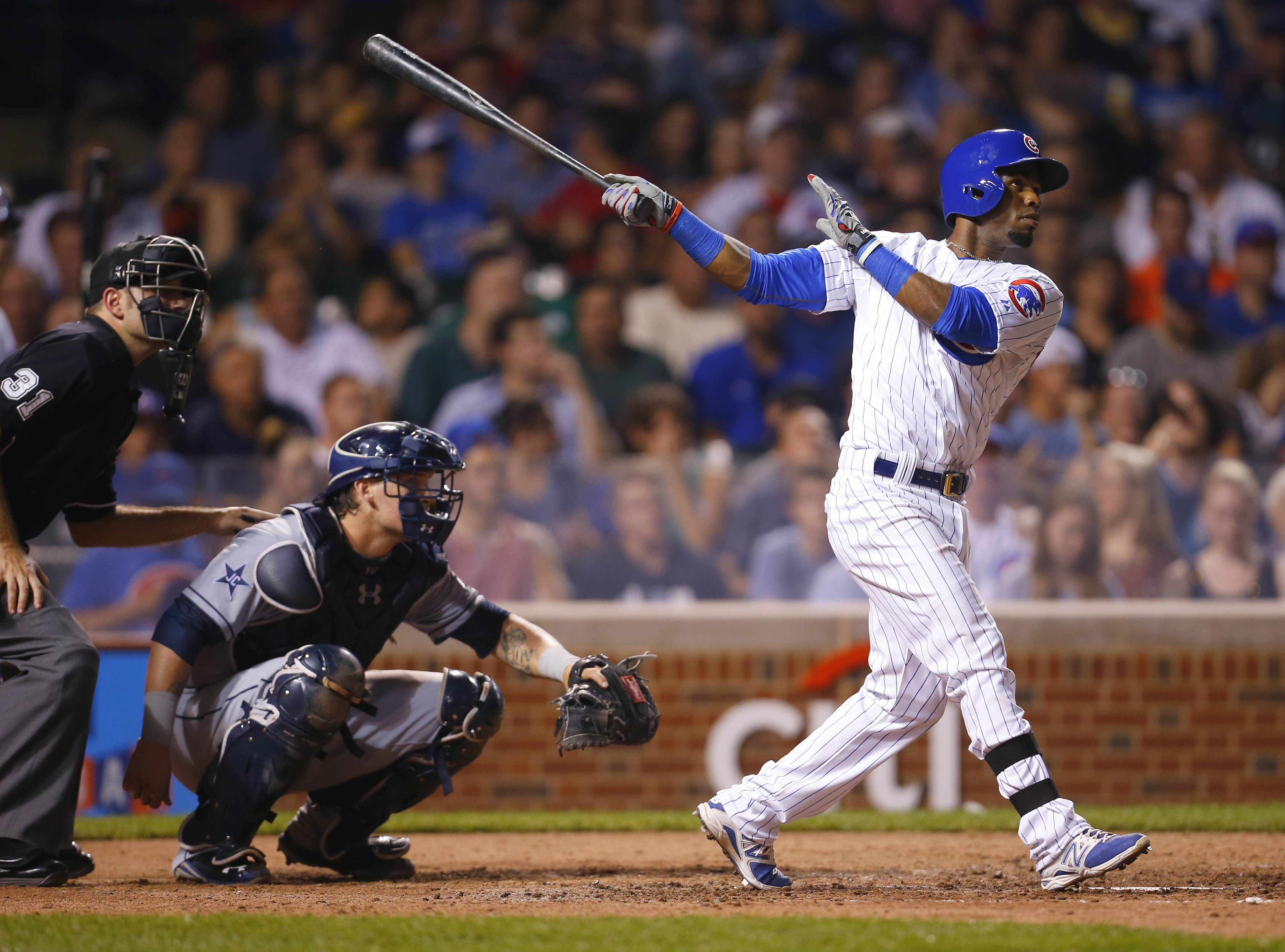 "Arismendy Alcantara watches his seventh-inning home run Tuesday at Wrigley Field. Jed Hoyer said it's time for Alcantara to ""be in the lineup every day."""