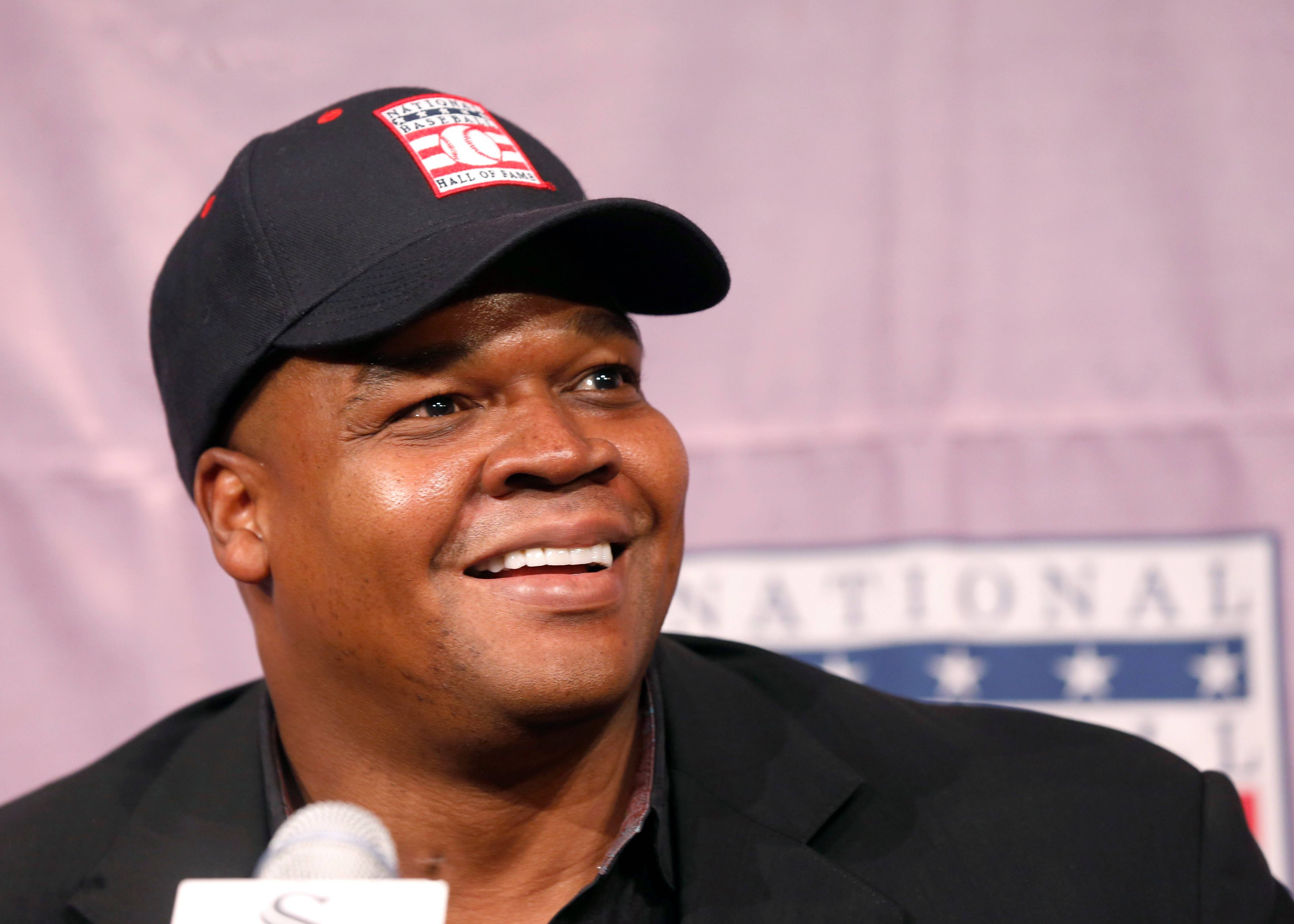 Frank Thomas smiles as he listens to a question during a news conference about his selection into the MLB Baseball Hall Of Fame in January.