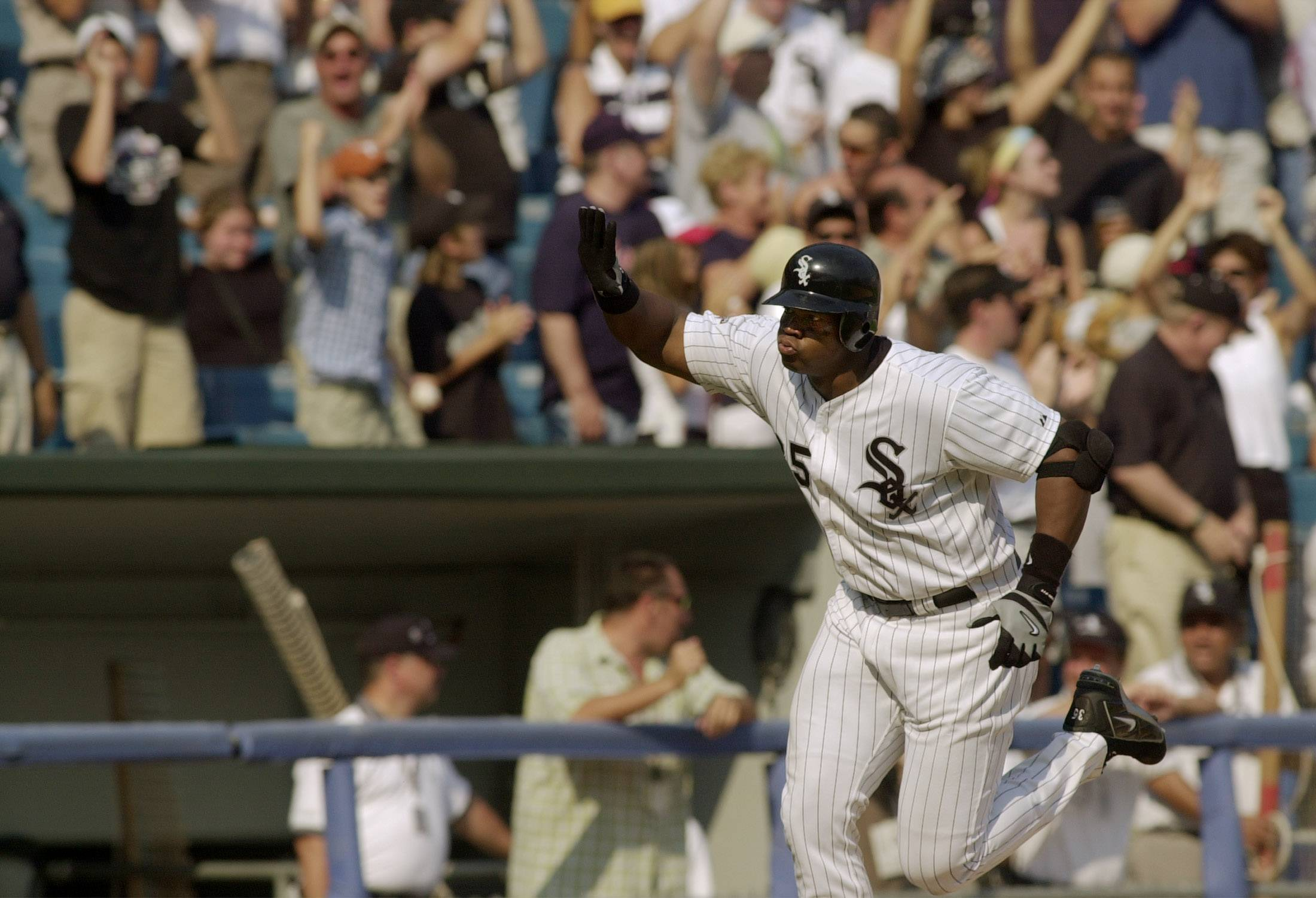 Frank Thomas rounds third base after a 3-run homer in 2003 against Cleveland.