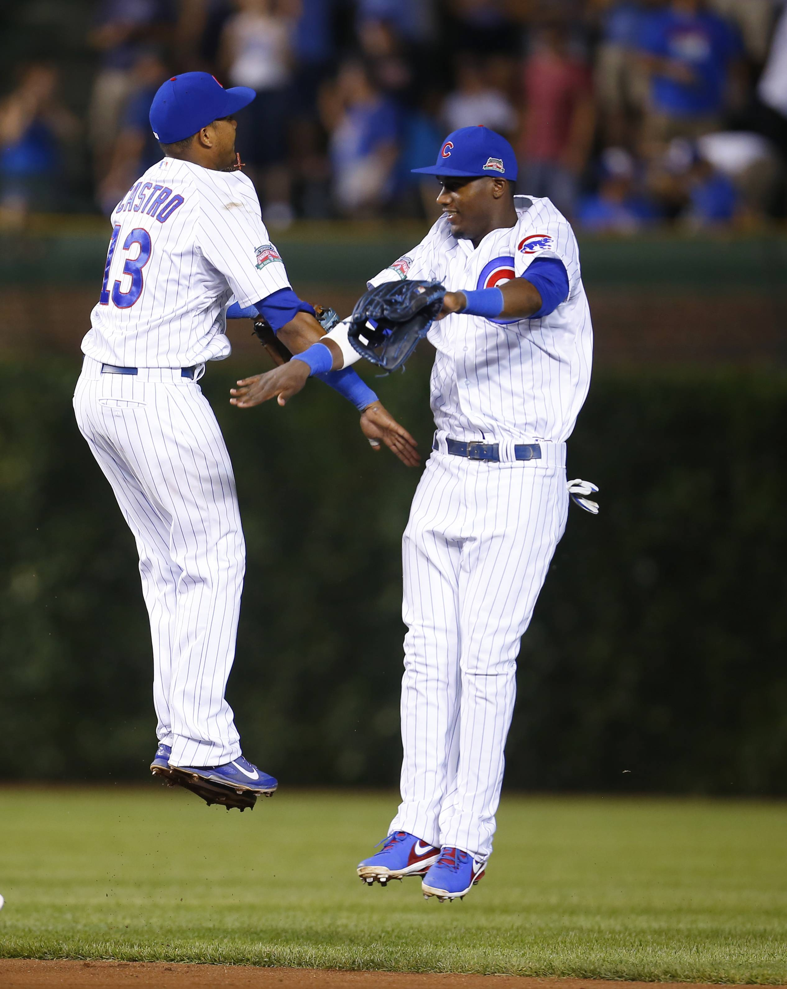 Cubs shortstop Starlin Castro (13) and left fielder Junior Lake celebrates after their baseball game against the San Diego Padres in Chicago, Tuesday, July 22, 2014. The Cubs won the game 6-0.