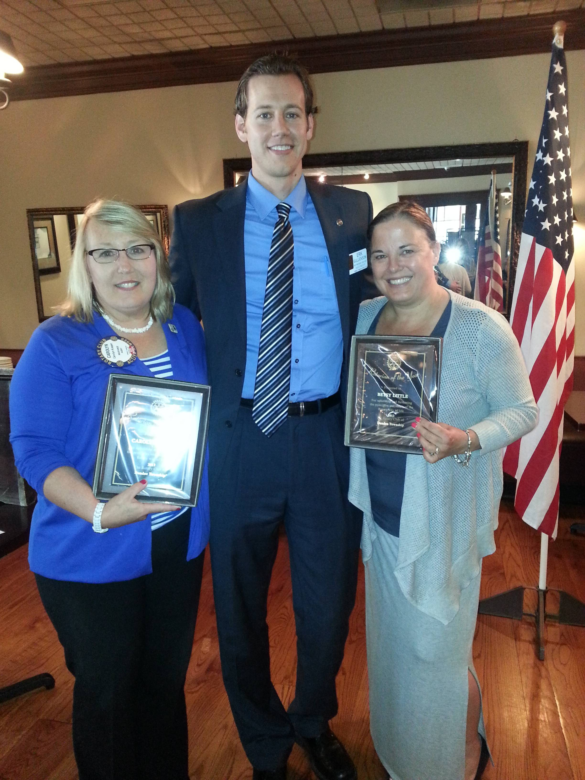 Eric Gullickson, center, recently named Carolyn Kasper, left, and Betsy Little as the club's Rotarians of the Year for their service during his presidency during the past 2013-14 year.