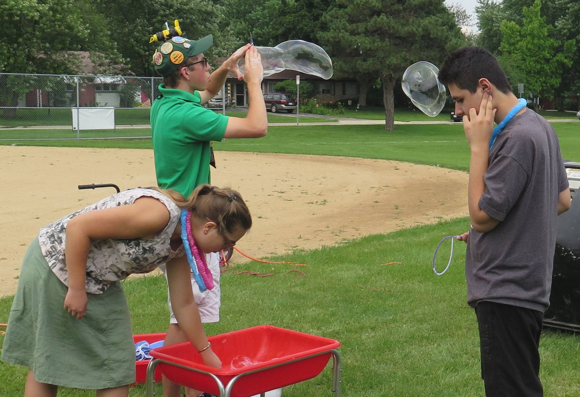 Brookfield Zoo's nature and science activities at the Schaumburg Township Disability Services hosted their annual picnic included super soap bubbles.