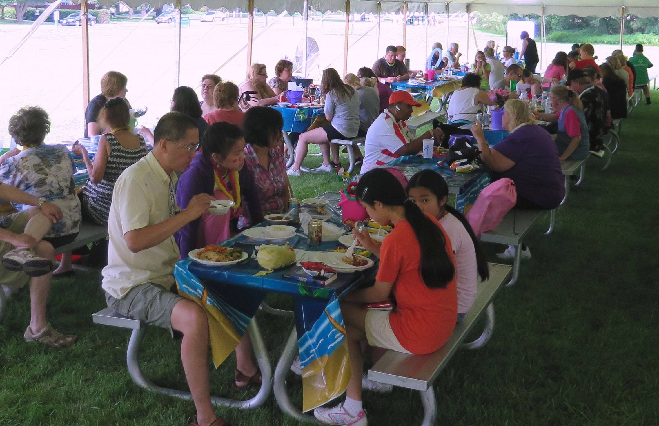 Guests at the annual Schaumburg Township disability Services picnic lunch on Village Tavern's chicken fingers and hot dogs before the bingo games begin.