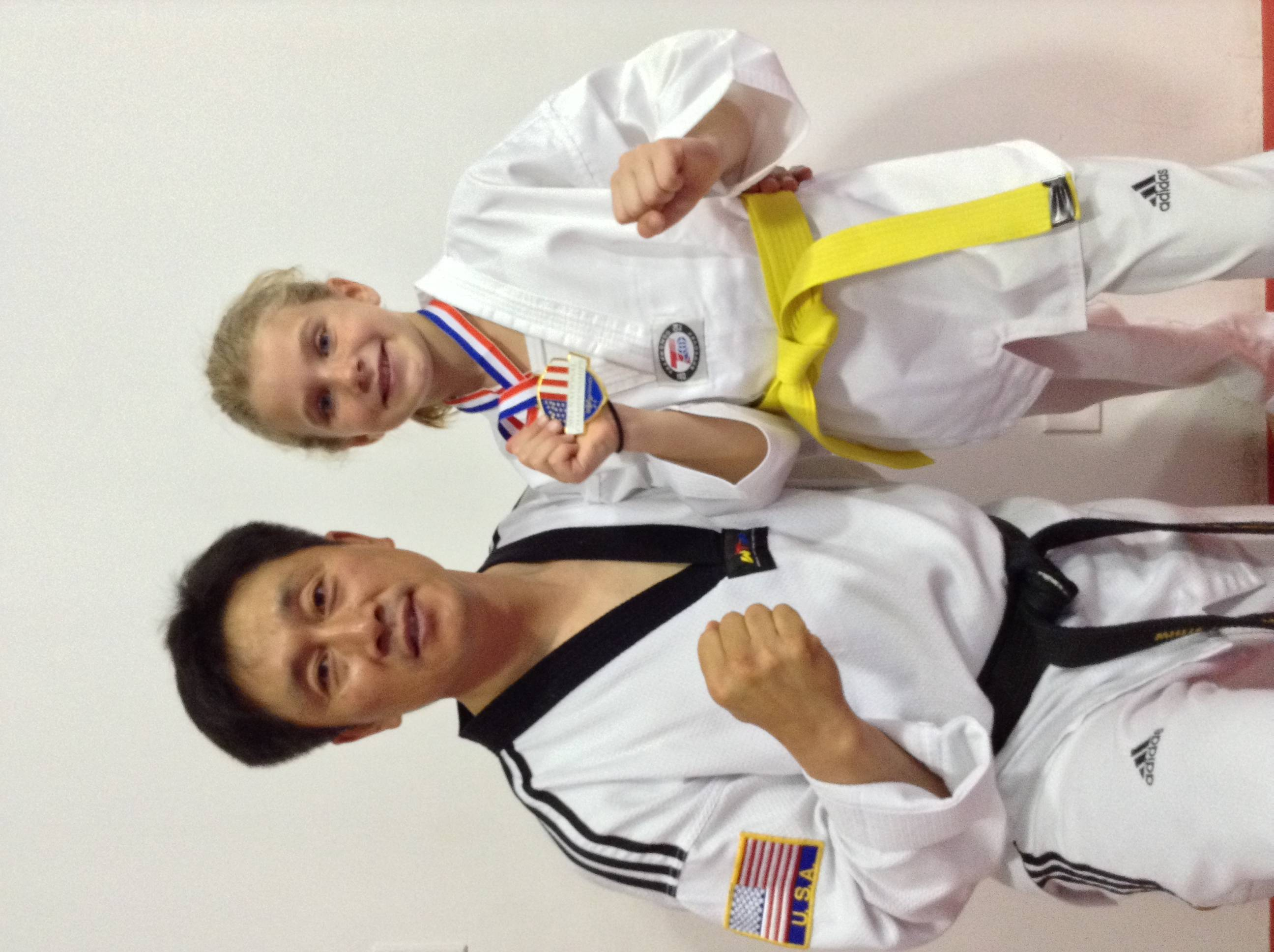 Head Master Shik Lee poses with his gold winning student Sophie Smithson, after her win at the USA Taekwondo National Championships.