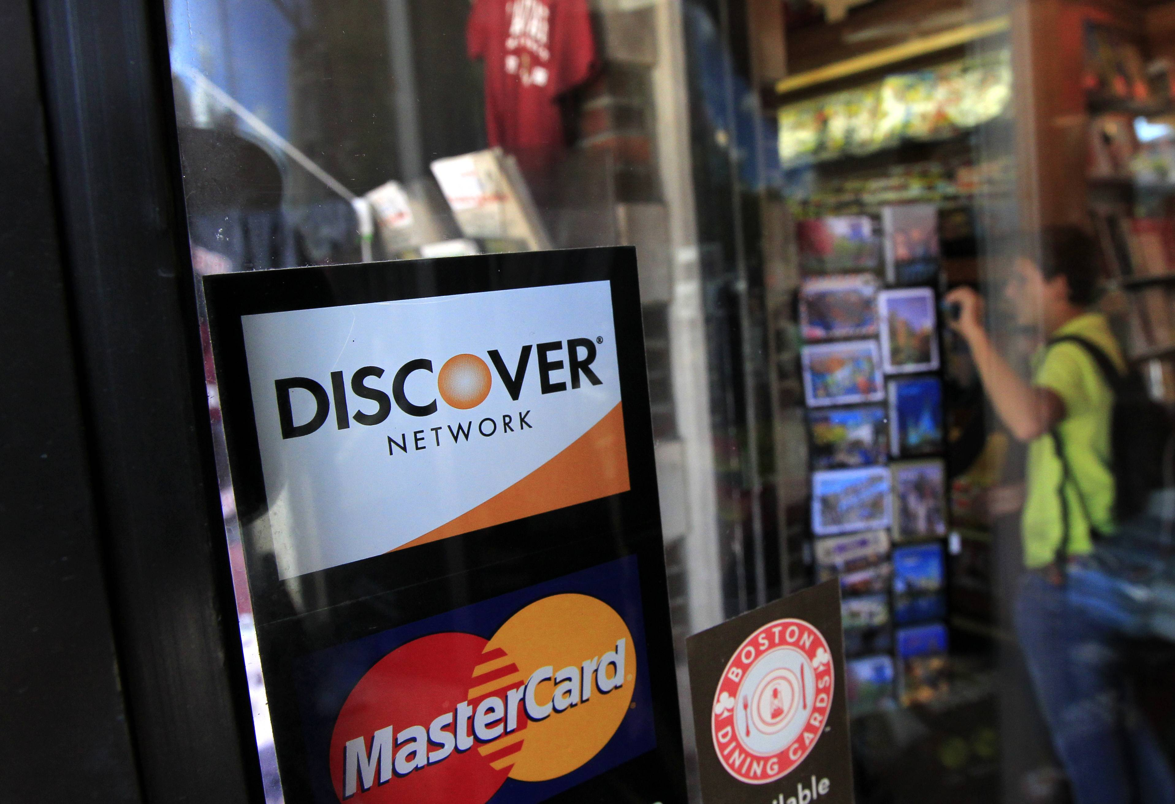 Riverwoods-based Discover Financial Services' net income grew 7 percent in the second quarter as credit card spending and overall loans increased from a year ago. The results beat Wall Street's expectations.