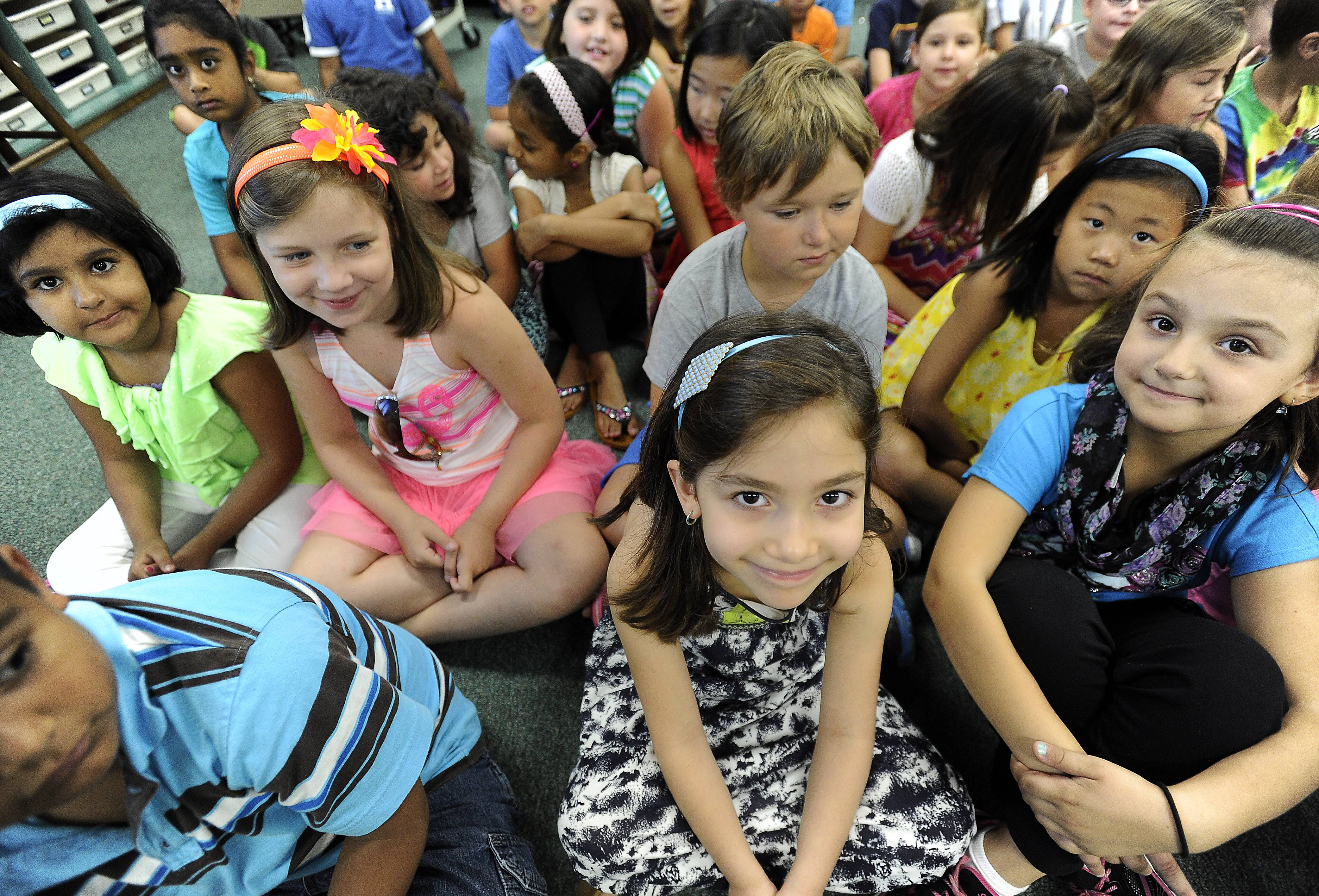 Kaylie Shaya, 7, of Des Plaines, sits with her classmates in teacher Athena Apostolakis' second grade class Wednesday during the first day of school at the Ridge Family Center for Learning in Elk Grove Village.