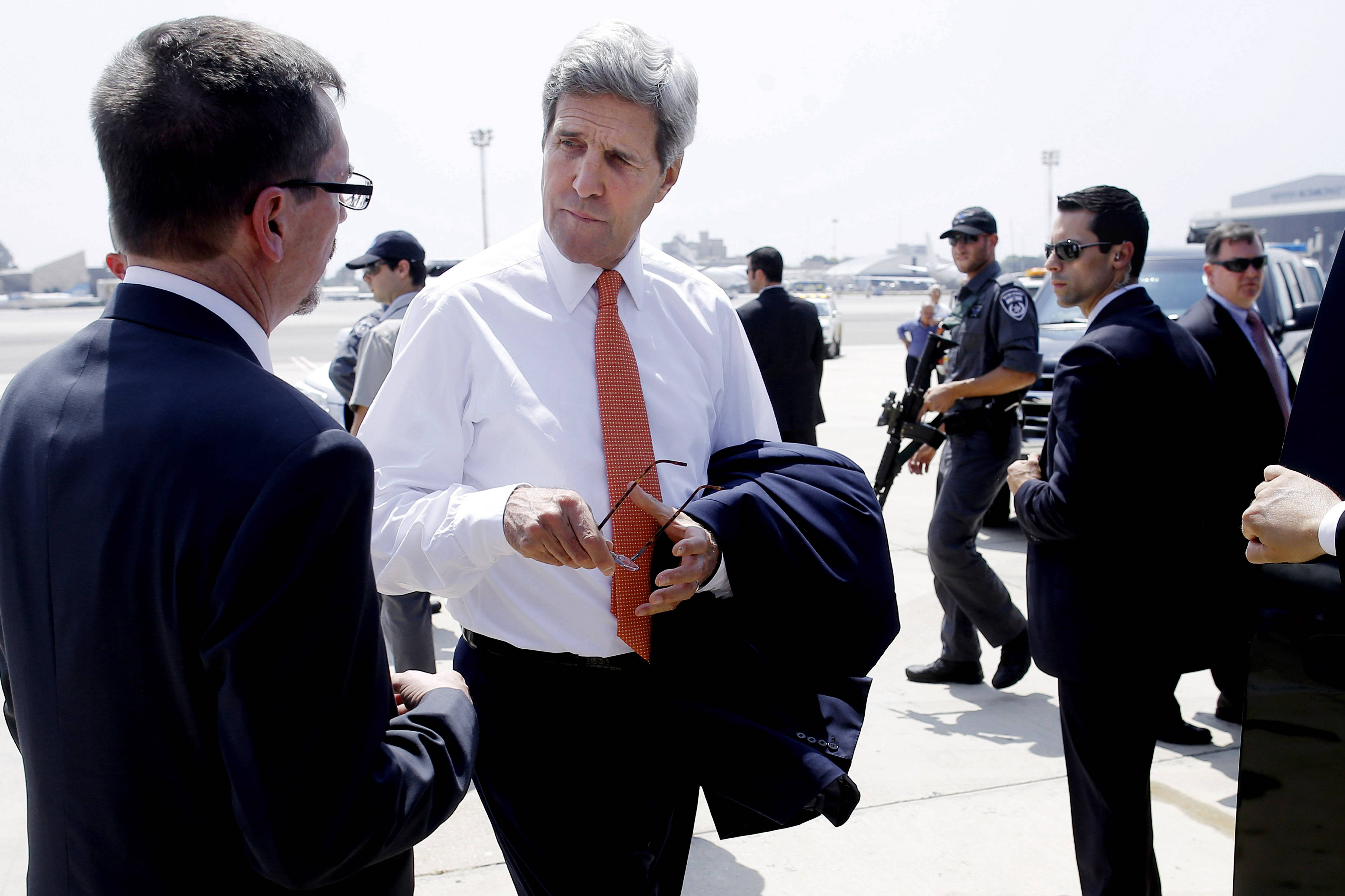 Secretary of State John Kerry, center, talks with U.S. Embassy Deputy Chief of Mission Bill Grant after his arrival in Tel Aviv, Israel, Wednesday. Kerry was to meet with U.N. Secretary-General Ban Ki-moon, Israeli Prime Minister Benjamin Netanyahu and Palestinian Authority President Mahmoud Abbas as efforts for a cease-fire between Hamas and Israel continued.