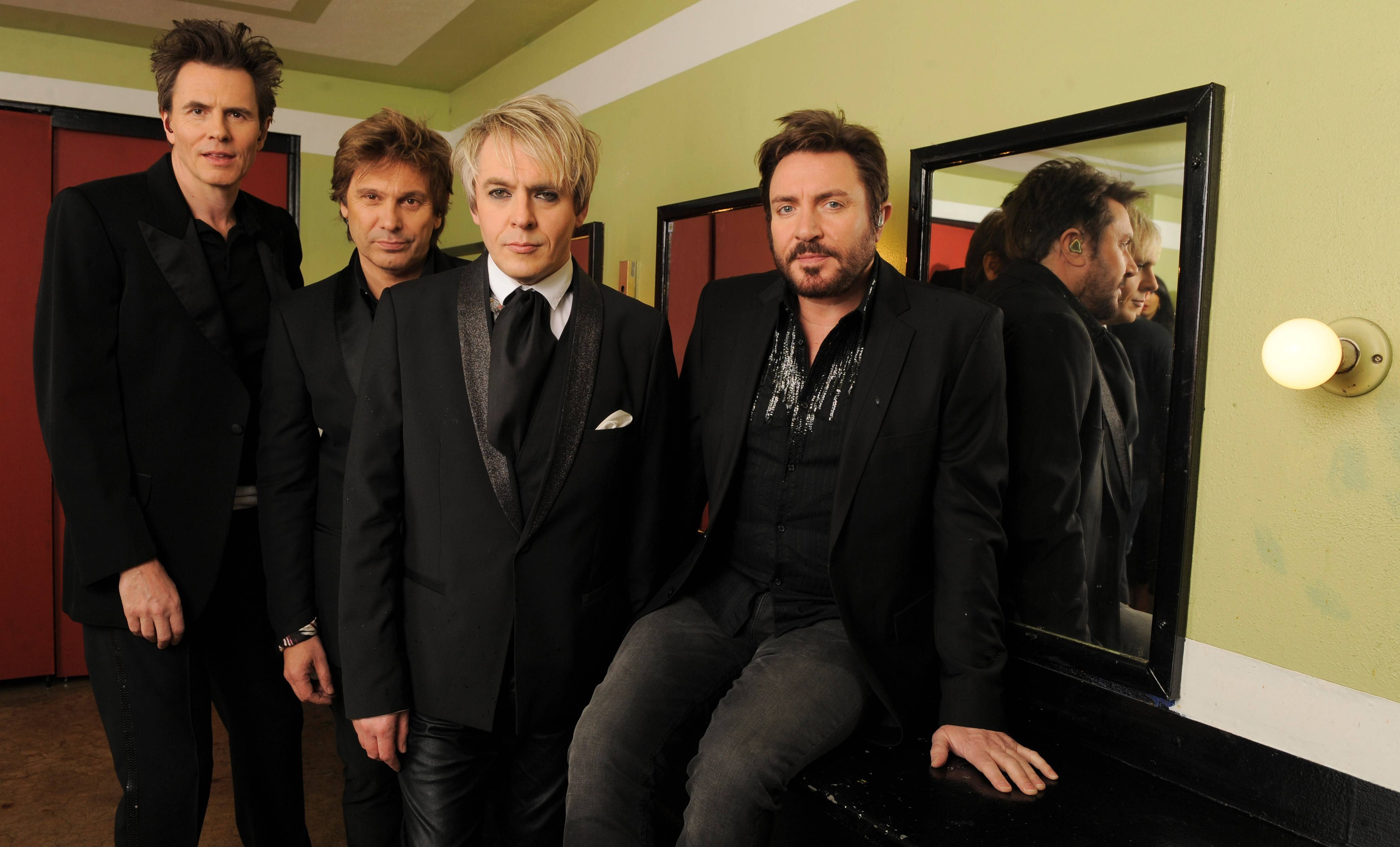 The band Duran Duran — featuring John Taylor, Roger Taylor, Nick Rhodes and Simon Le Bon — is suing a Glenview-based fan club management company.