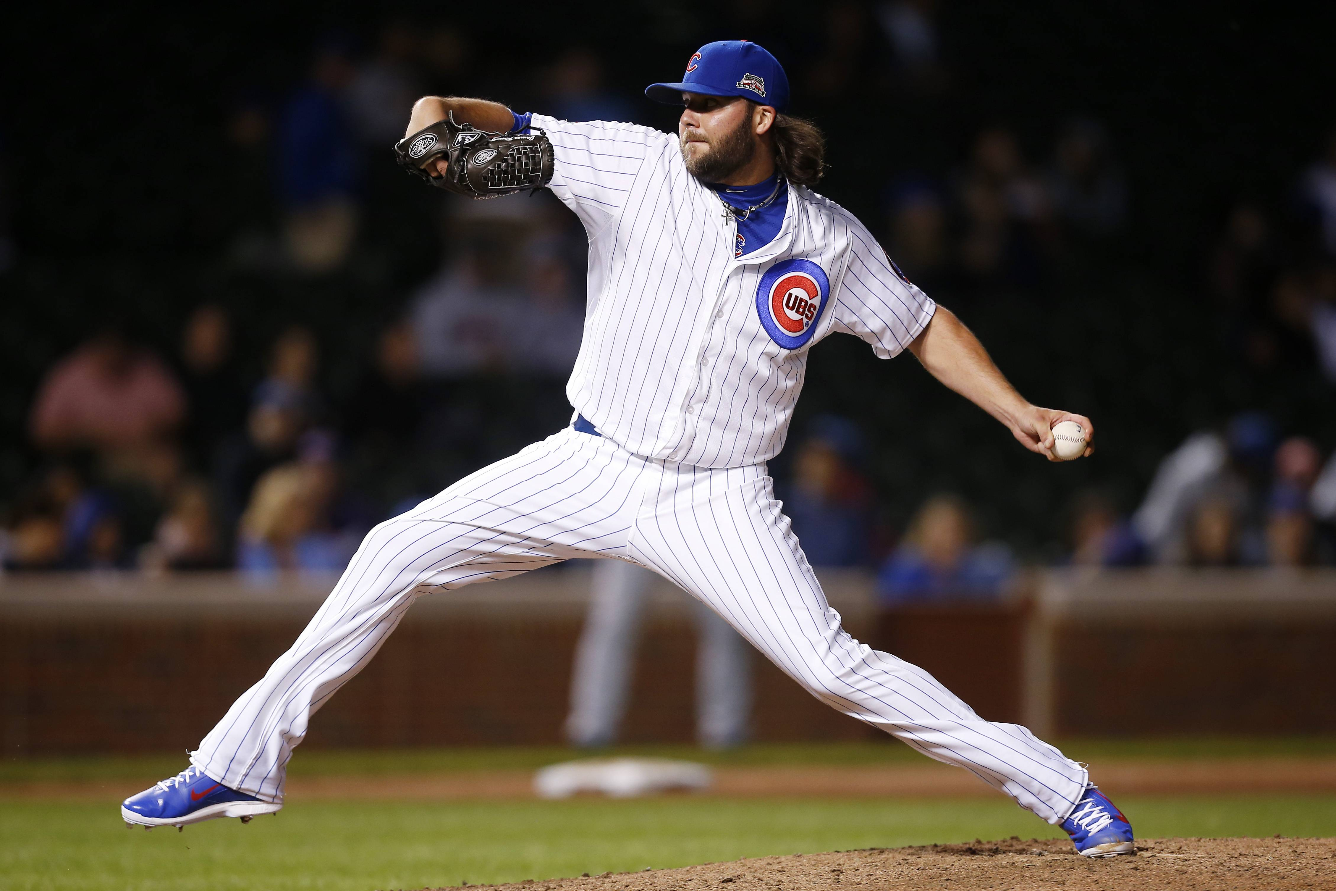 Cubs relief pitcher James Russell delivers against the San Diego Padres during the ninth inning of a baseball game on Wednesday, July 23, 2014, in Chicago.