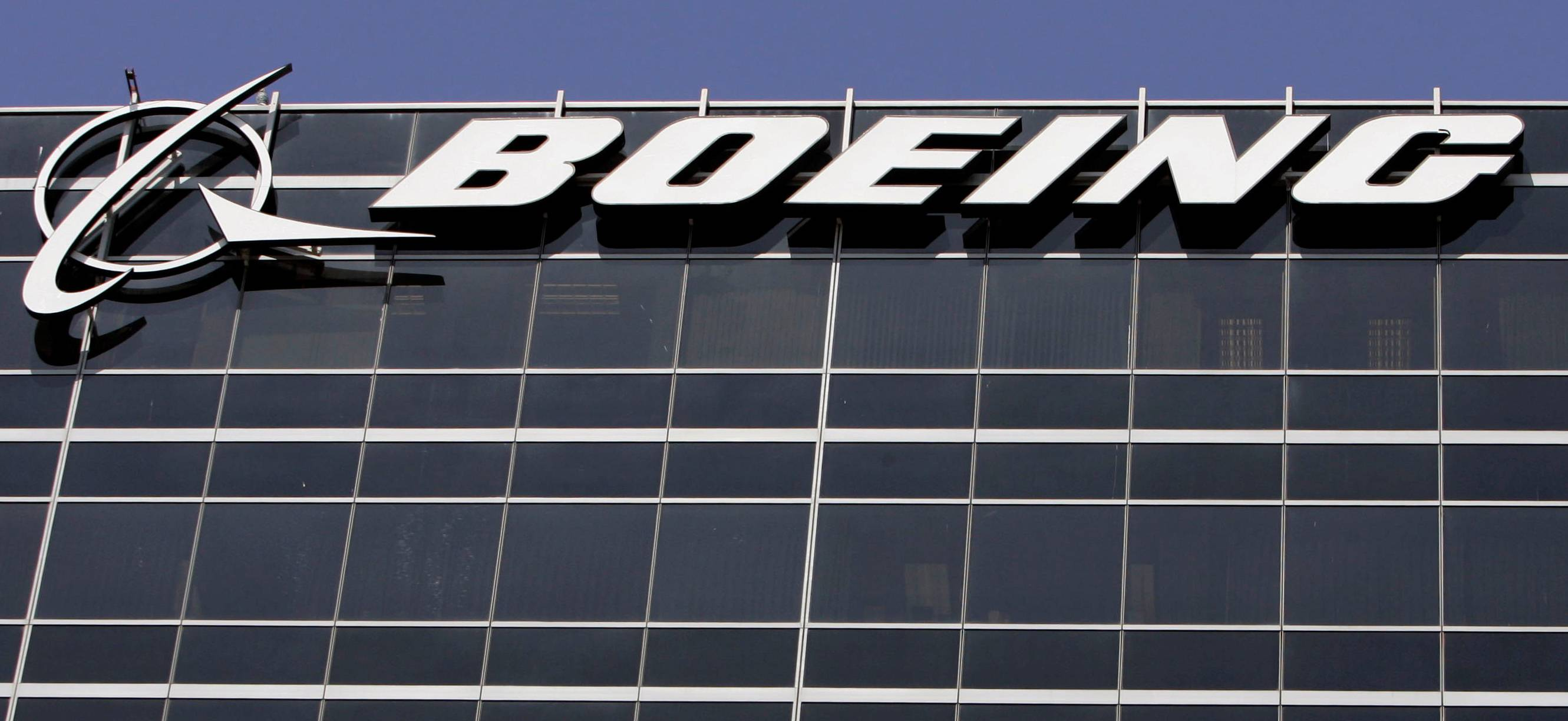 Chicago-based Boeing Co. raised its full-year profit forecast as the world's biggest planemaker reaps gains from faster production that is driving jetliner deliveries to record levels.