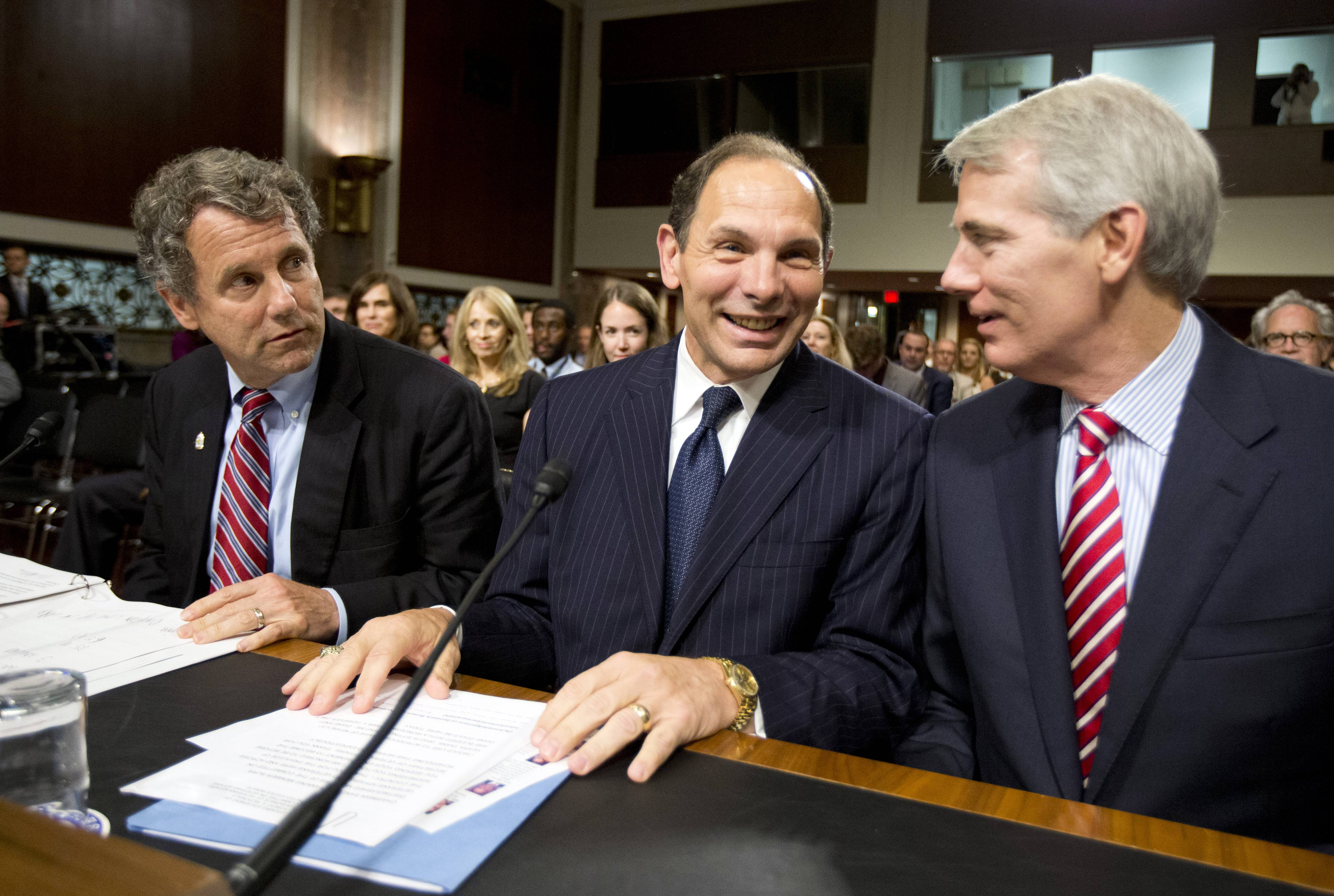 The Senate Veterans' Affairs Committee unanimously endorsed former Procter & Gamble CEO Robert McDonald to be the new secretary of Veterans Affairs Wednesday. McDonald is seen here during his confirmation hearing Tuesday, flanked by Sens. Sherrod Brown, left, and Rob Portman, right.