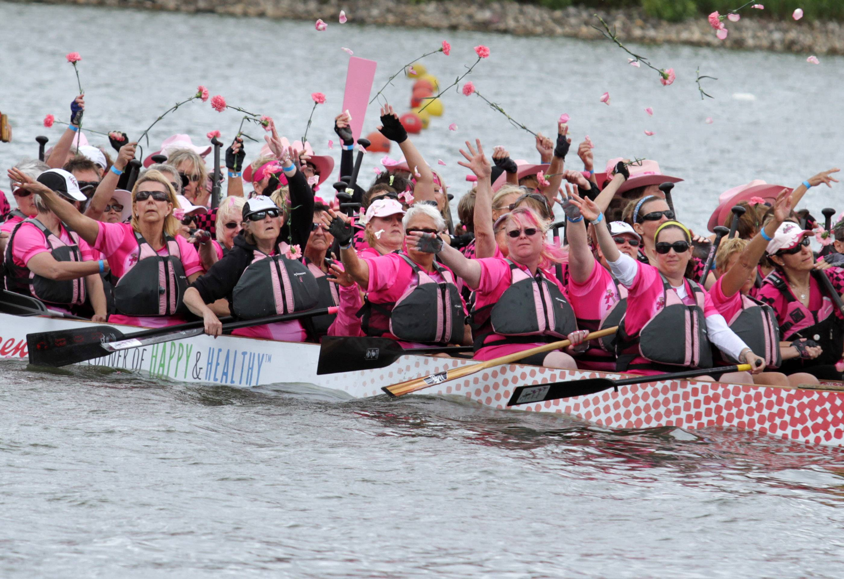 Cancer survivor teams wore pink and held a ceremony throwing roses into Lake Arlington prior to the 2013 event.