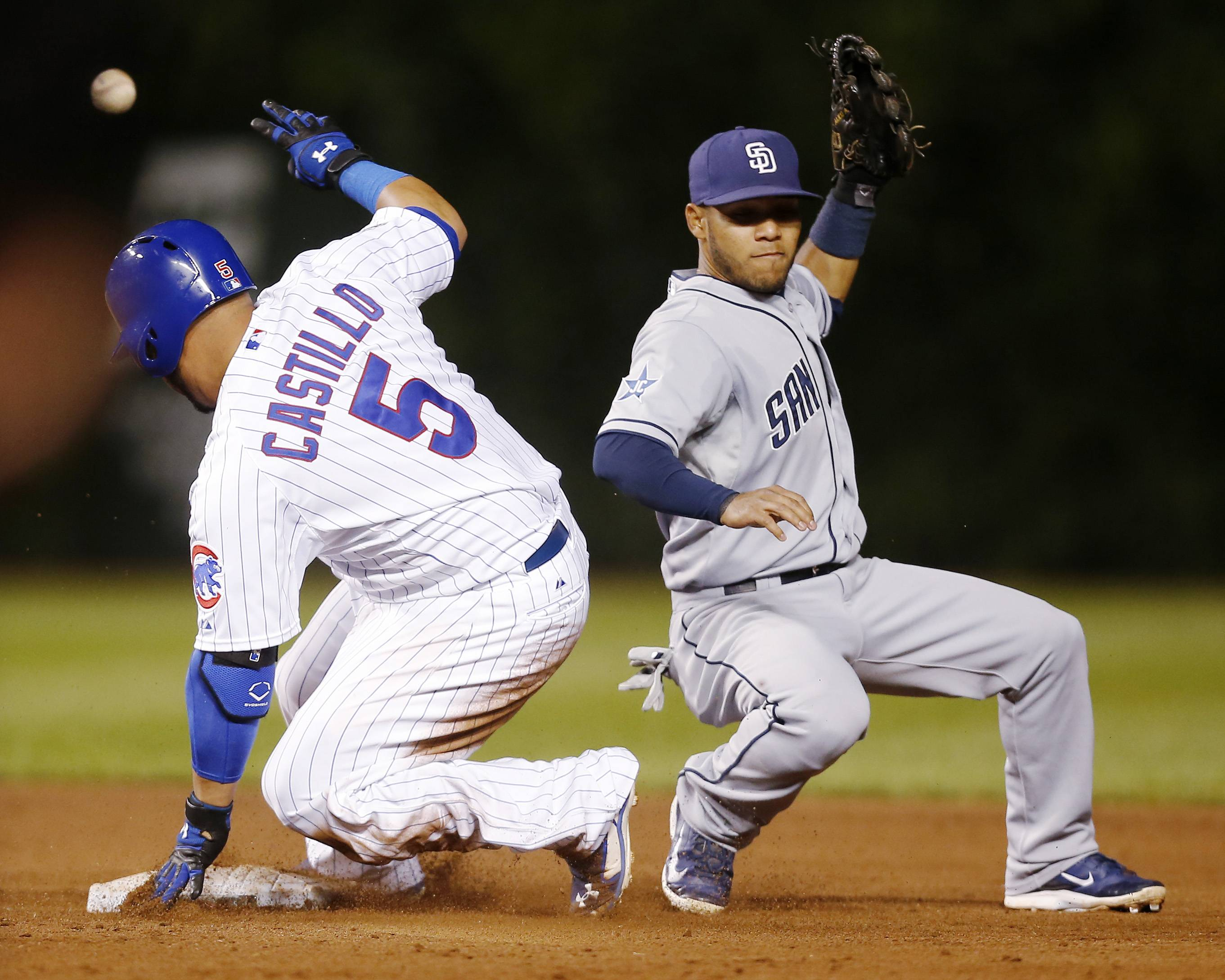 Cubs' Welington Castillo is safe at second on a double as San Diego Padres shortstop Alexi Amarista loses the ball during the fifth inning of a baseball game on Wednesday, July 23, 2014, in Chicago.