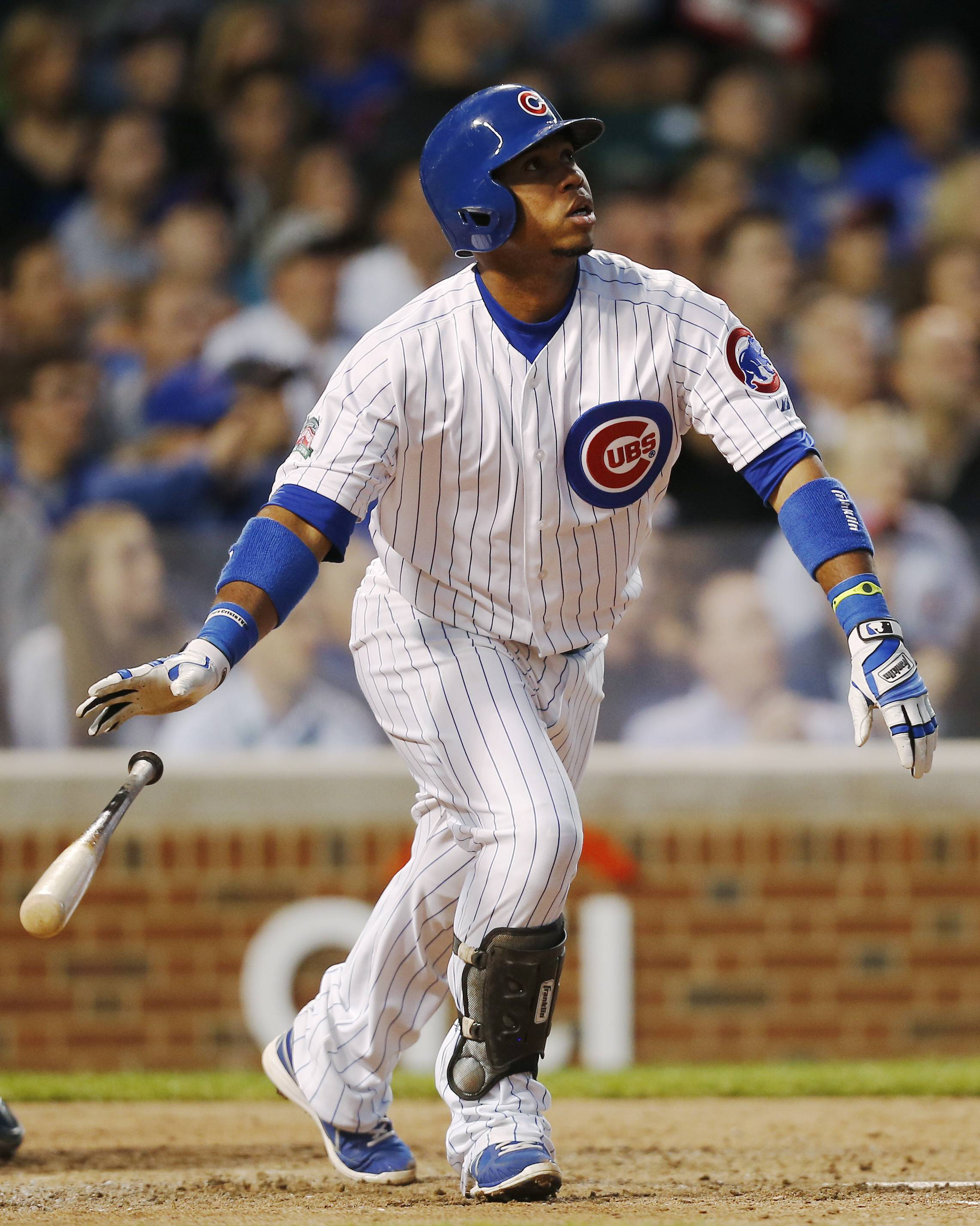 Chicago Cubs' Luis Valbuena hits a three-run home run against the San Diego Padres during the fourth inning of a baseball game on Wednesday, July 23, 2014, in Chicago.