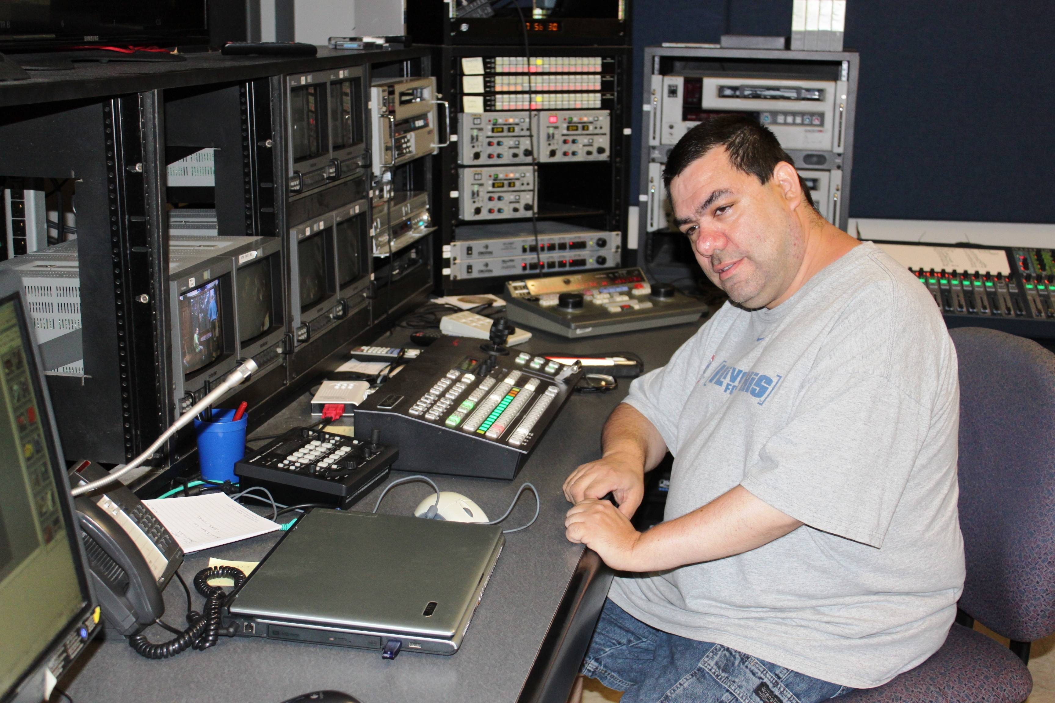 Jeremy Schumann of Lombard works at the editing board at ACTV in Addison as part of a new NEDSRA program to introduce participants to how an actual TV studio works.