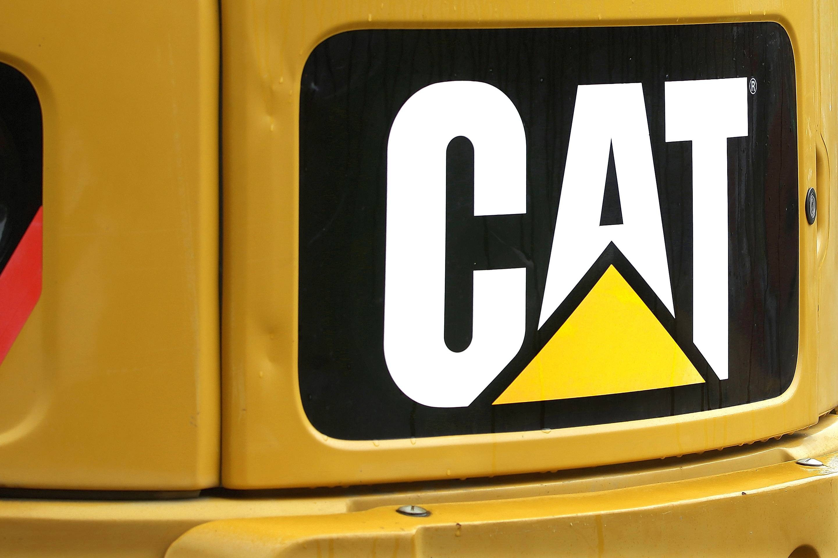 Caterpillar's second-quarter net income rose 4.1 percent even as revenue slipped.