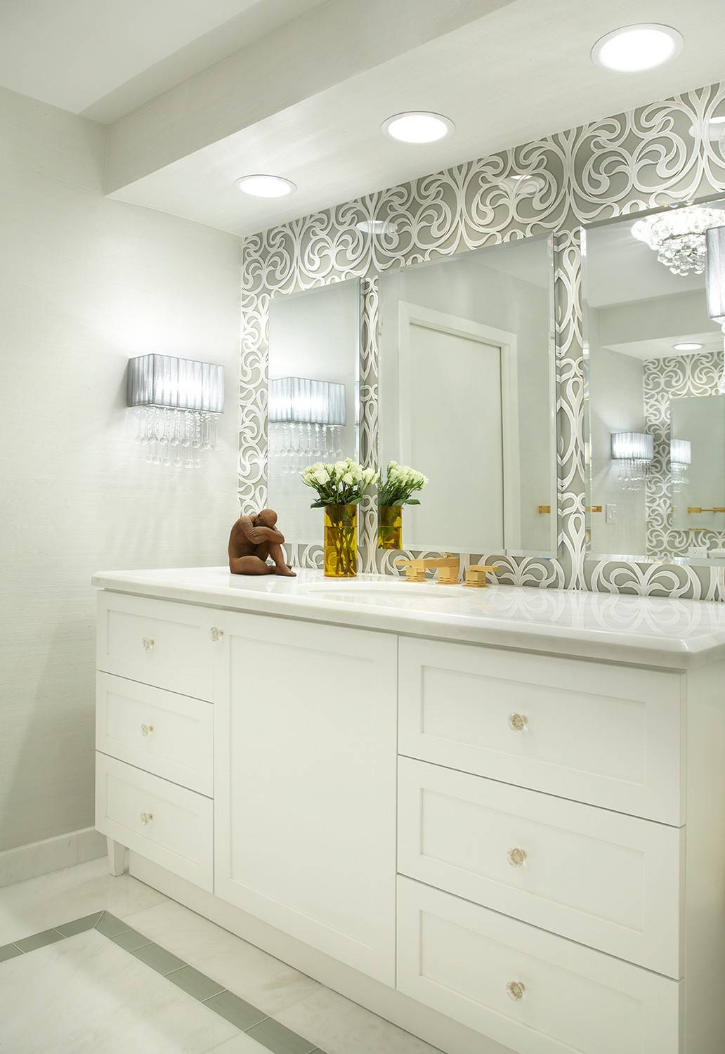 Instead of one large master bathroom, designers today are suggesting two smaller ones to avoid conflict.