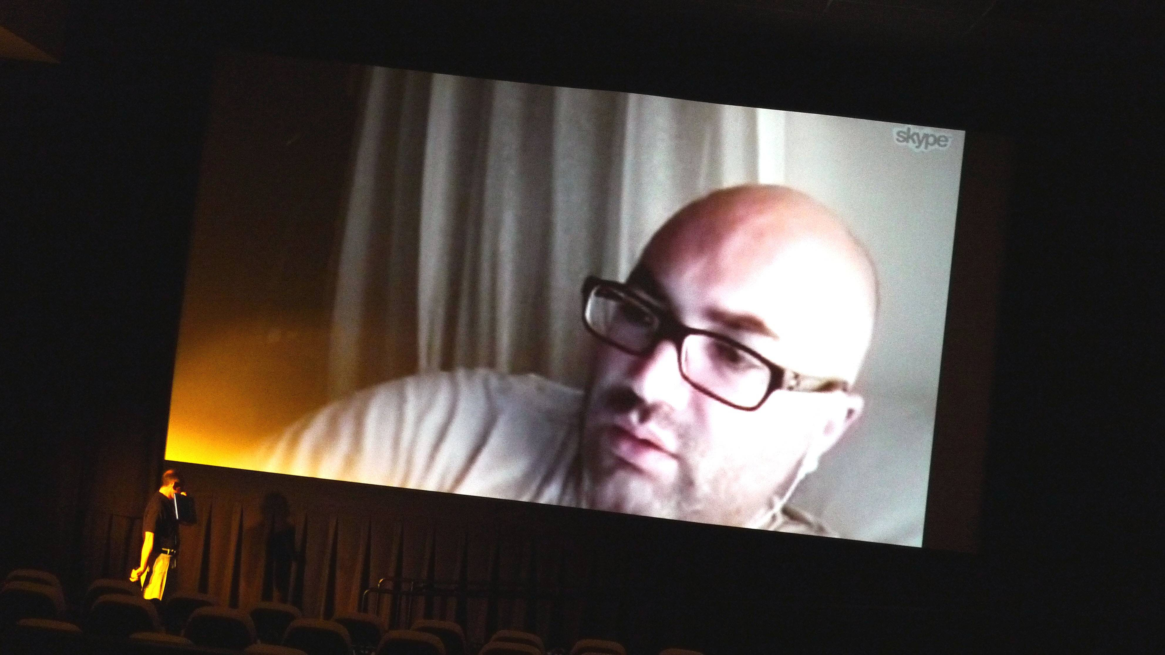 French filmmaker Karim Ouret is interviewed on Skype by J. Spencer Greene, left, at the opening night of the Blue Whiskey Film Festival in Arlington Heights.