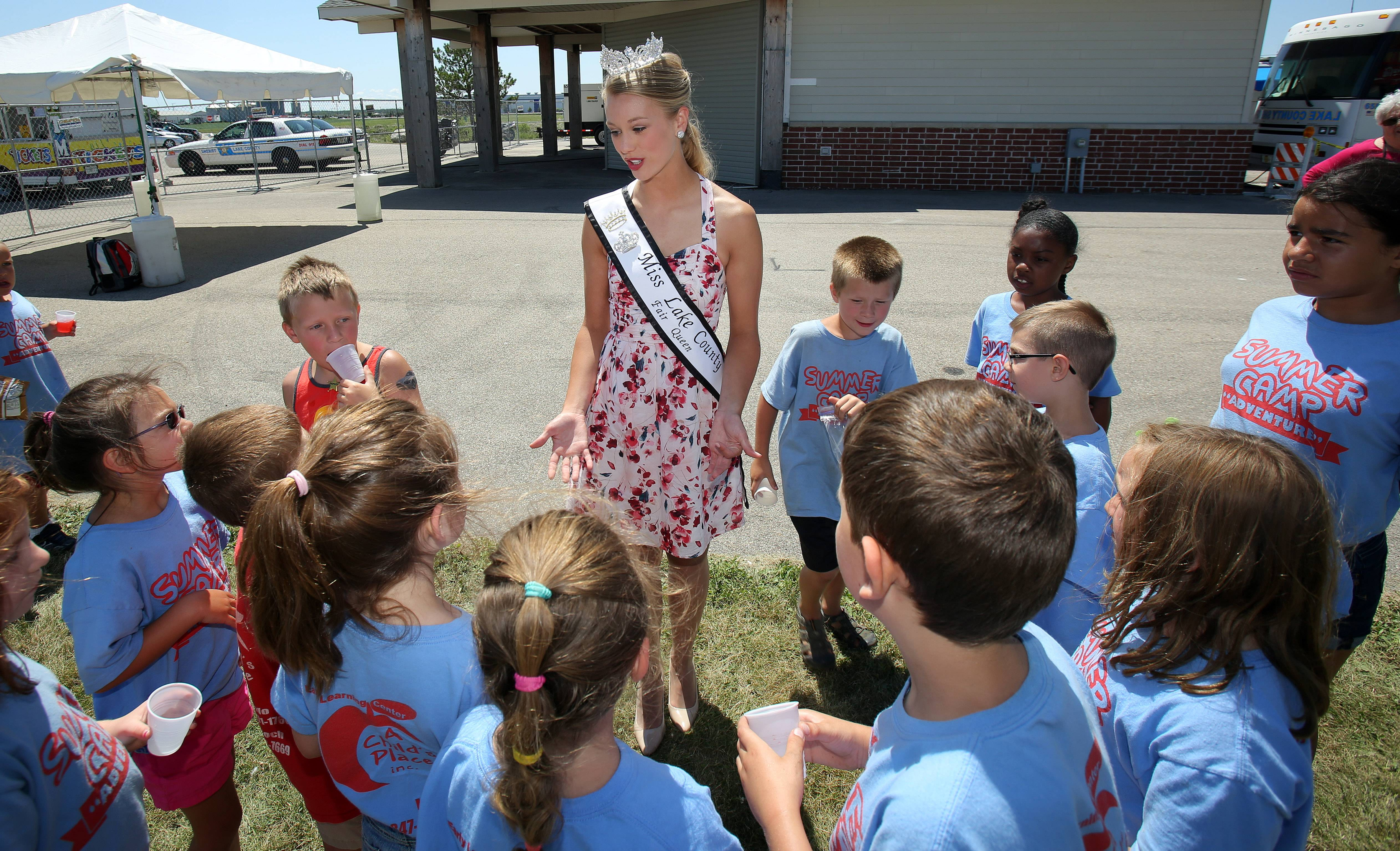 Miss Lake County Fair 2014 Julia Bauschke, 19, talks with summer camp kids from A Children's Place Thursday at the Lake County Fair in Grayslake.