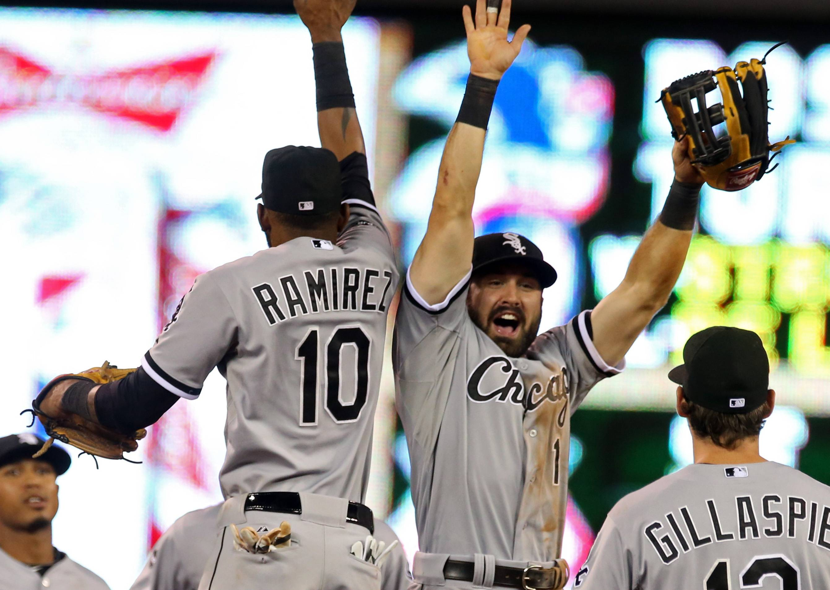 Chicago White Sox' Adam Eaton (1) and Alexei Ramirez celebrate after they defeated the Minnesota Twins 5-2 in a baseball game on Thursday, July 24, 2014, in Minneapolis. (AP Photo/Jim Mone)