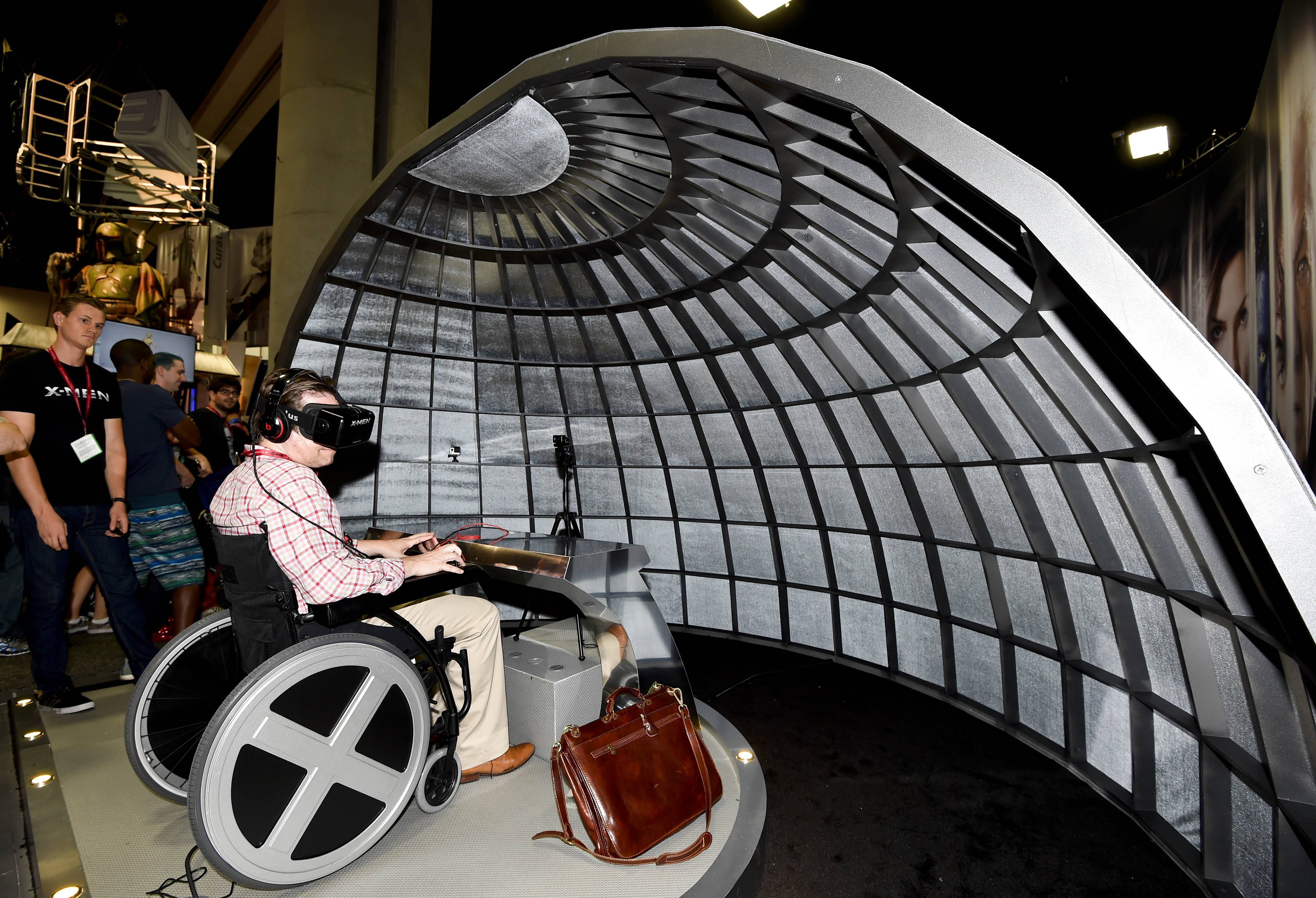 A Comic-Con fan sits in the X-Men Cerebral Experience during preview night Wednesday at the 2014 Comic-Con International Convention in San Diego.