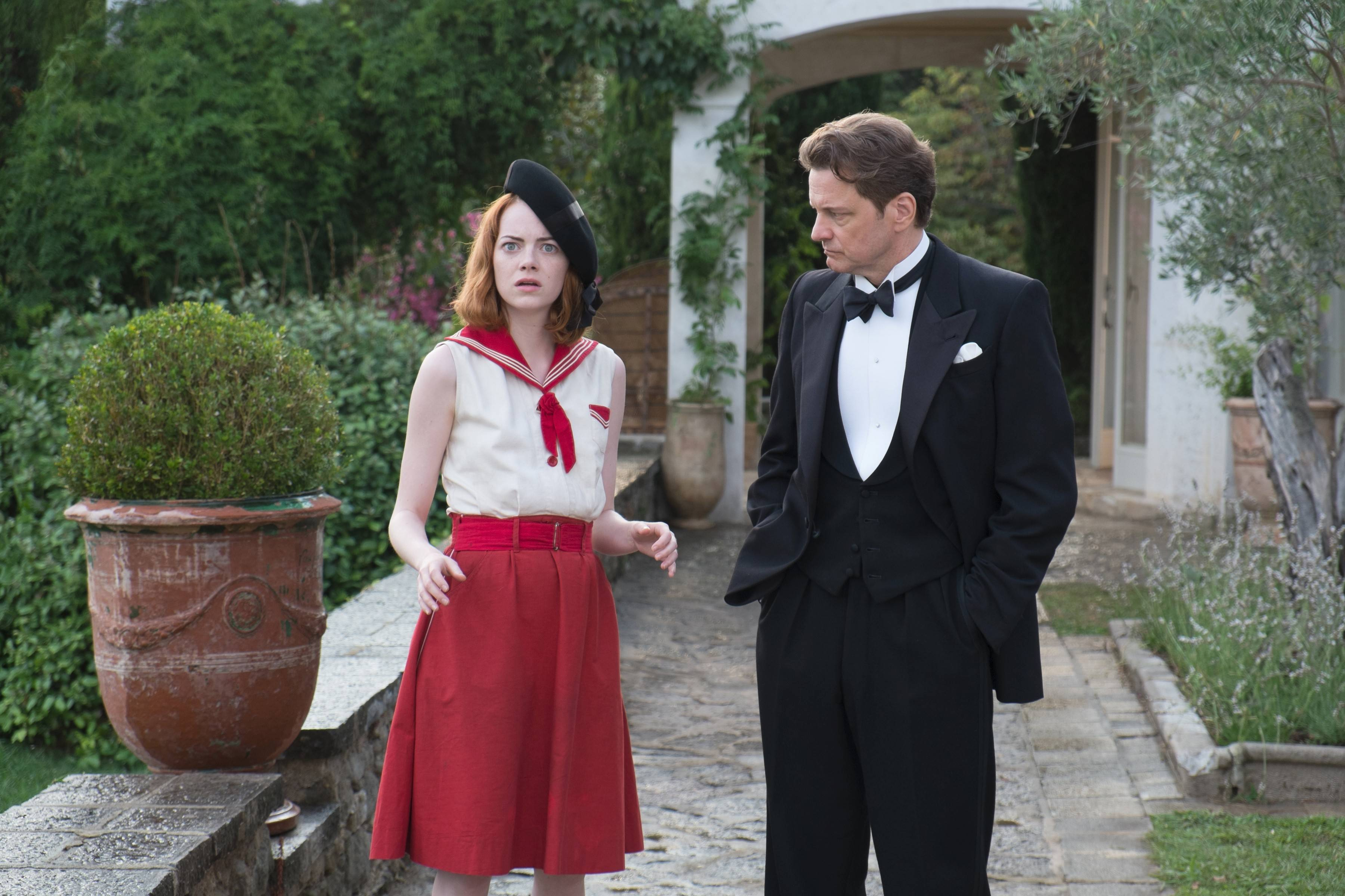 "Magician Stanley Crawford (Colin Firth) tries to debunk a psychic (Emma Stone) in Woody Allen's comic drama ""Magic in the Moonlight."""