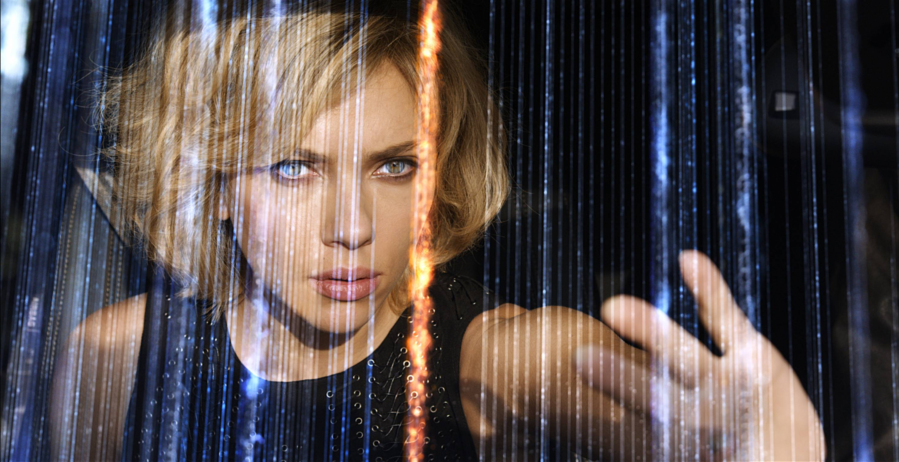 "In ""Lucy,"" Scarlett Johansson plays a woman with the ability to see wireless cellphone signals showering the skies."