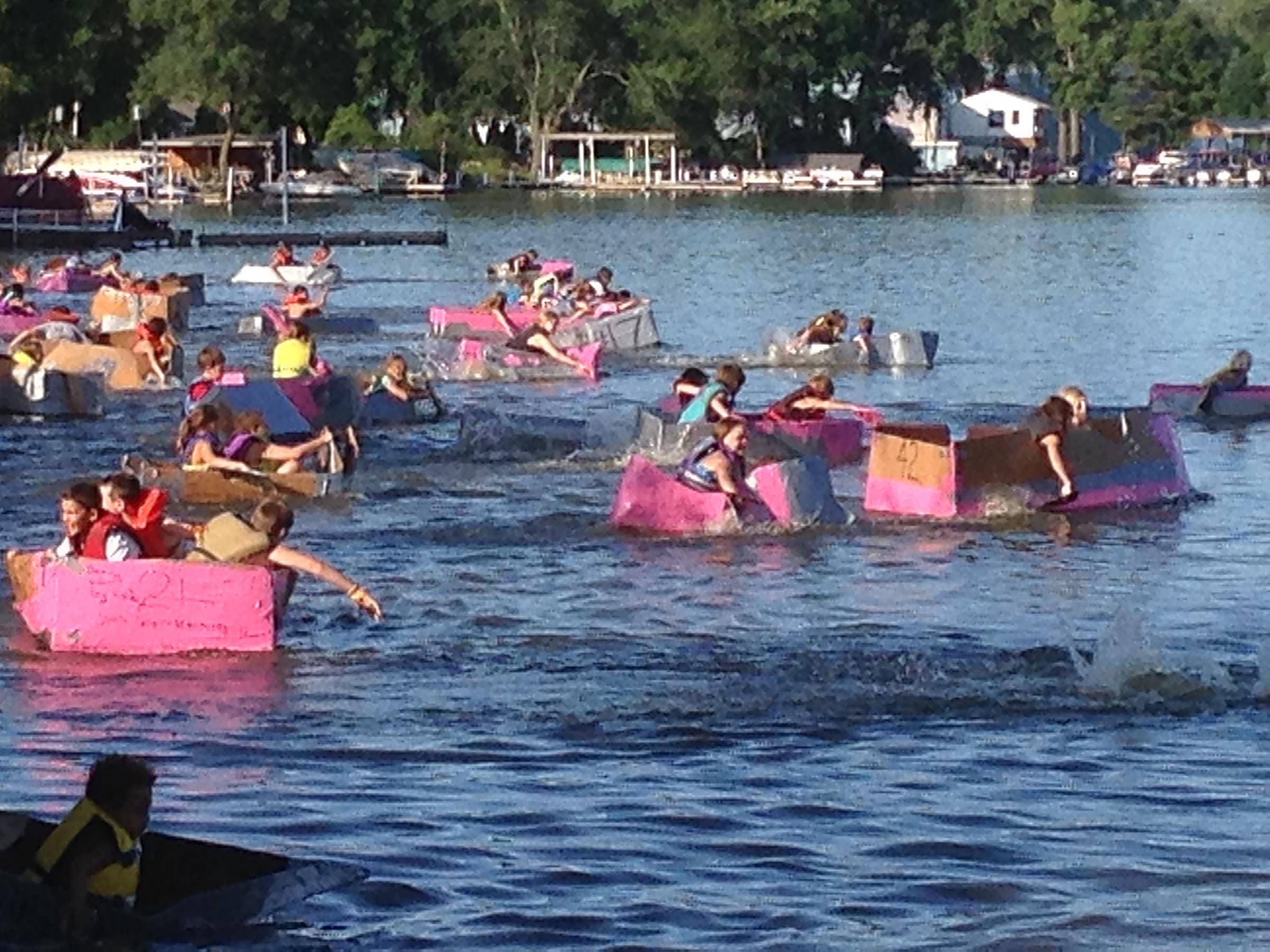 Competitors in the Pee Wee division leave the shore during the Founders Day Cardboard Boat Regatta Thursday along the Fox River in Algonquin. Each racer had 2½ hours to build their boat.