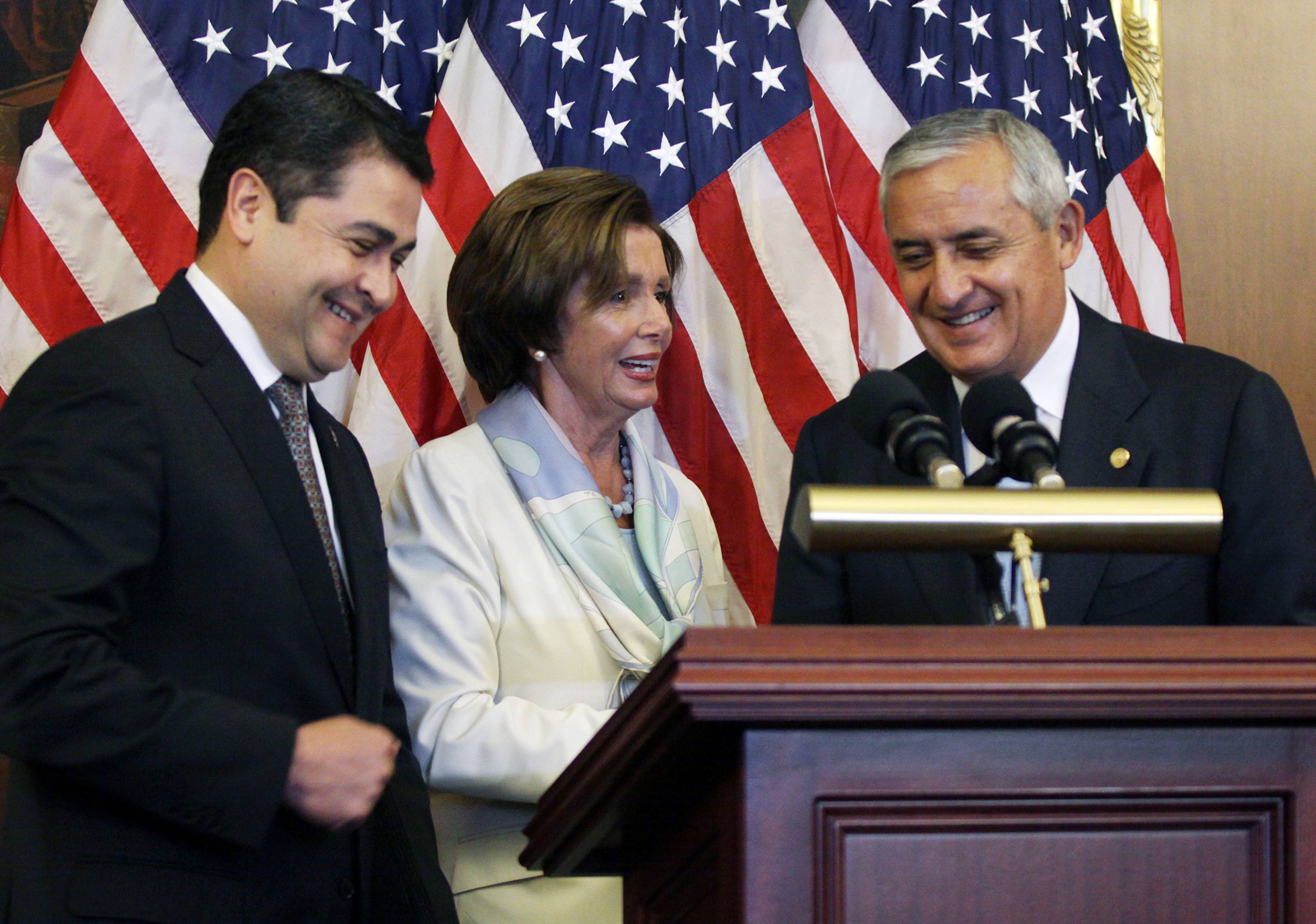 House Democratic Leader Nancy Pelosi, center, is seen with Guatemalan President Otto Molina, right, and Honduran President Juan Hernández on Thursday on Capitol Hill in Washington. At the same time, the administration said it is weighing giving refugee status to young people from Honduras.