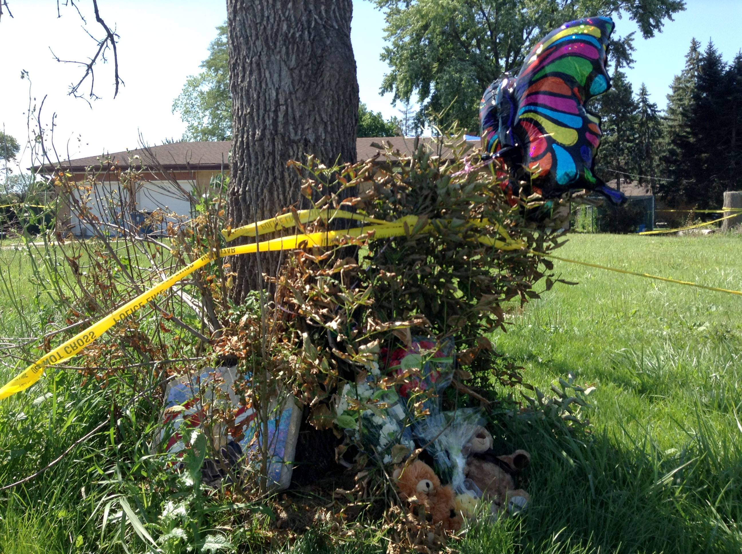 A makeshift memorial was set up Thursday morning outside the Bensenville house where a 4-year-old boy died Wednesday in a fire.