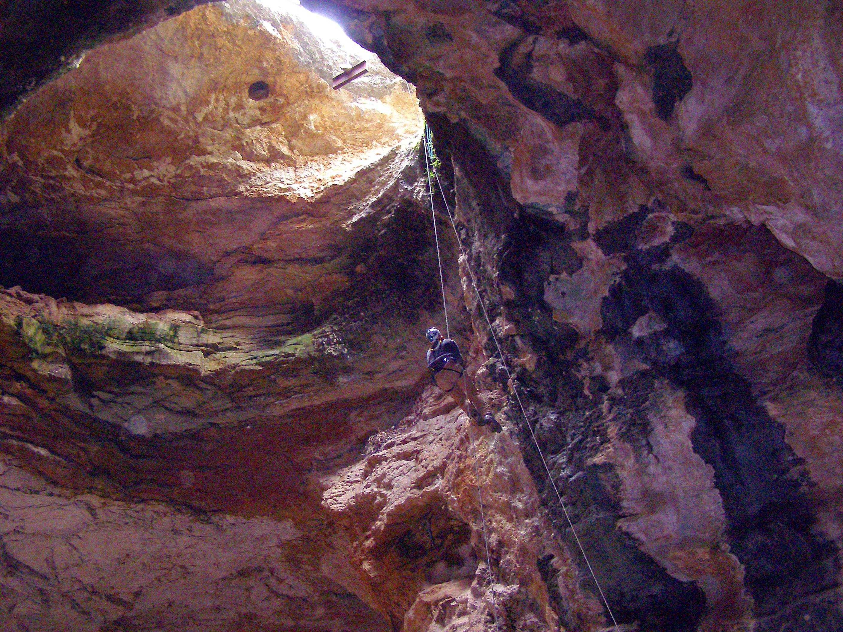 Bureau of Land Management cave specialist Bryan McKenzie rappels into Natural Trap Cave in north-central Wyoming during a cleanup expedition.