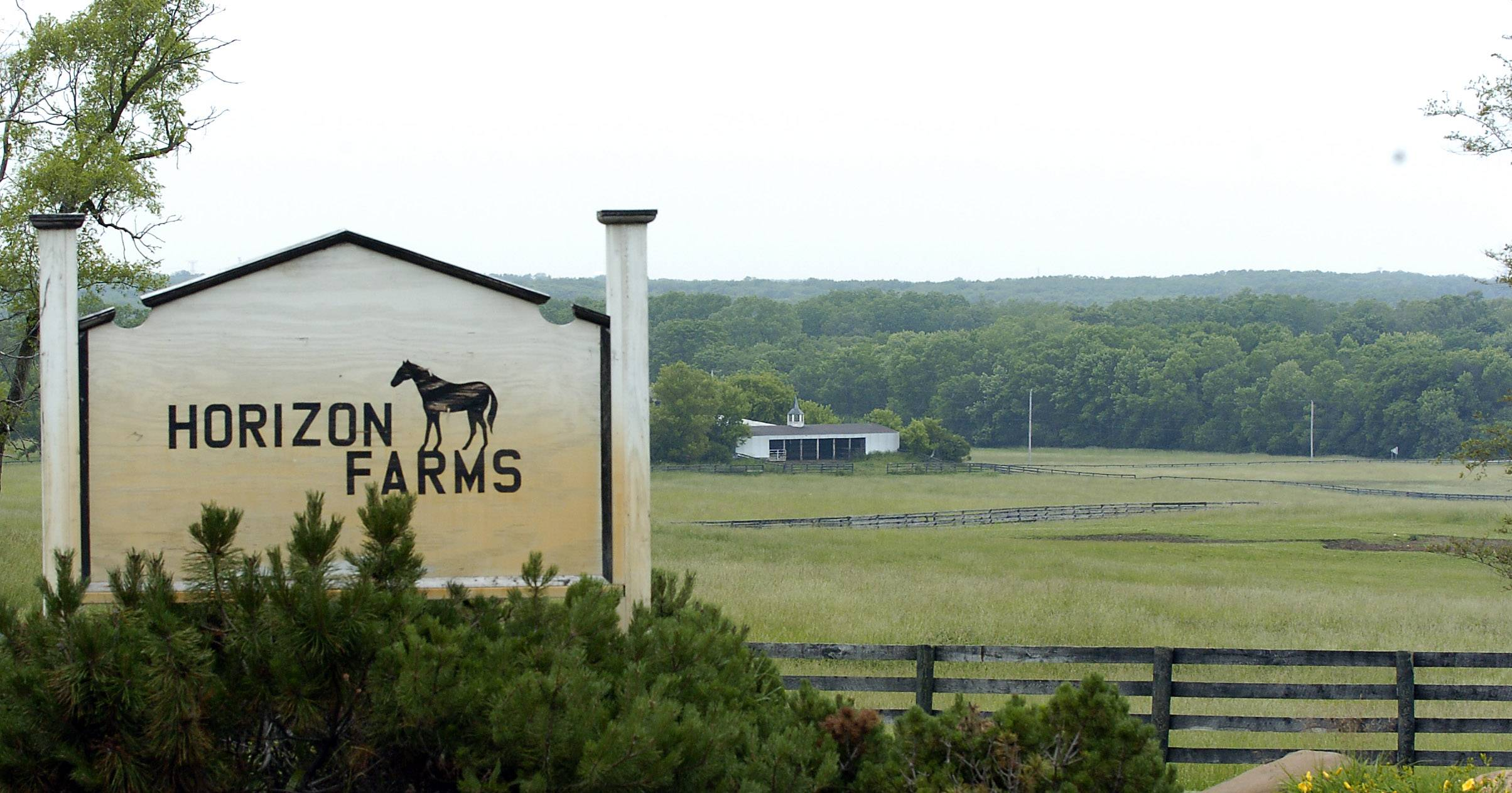A sign marks the main road of Horizon Farms, a 400-acre equestrian estate in Barrington Hills, which the Cook County Forest Preserve District owns. The previous owners have filed a lawsuit against the district and several others alleging fraud in the sale that gave the forest district ownership.