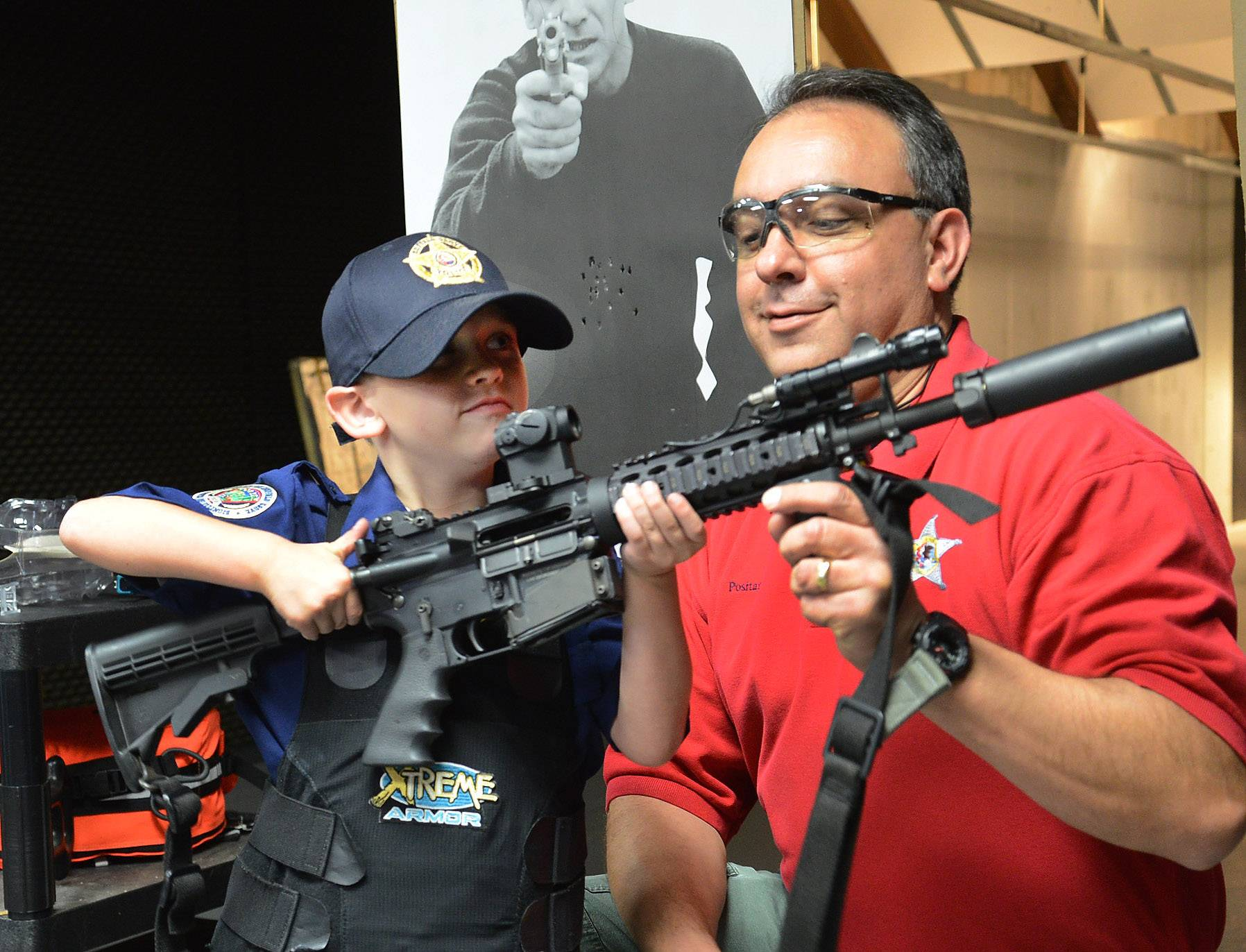 Adam Brodersen gets a lesson on how to shoot a AR15 patrol rifle from firearms instructor Sgt. Vince Positano at the Buffalo Grove police department.