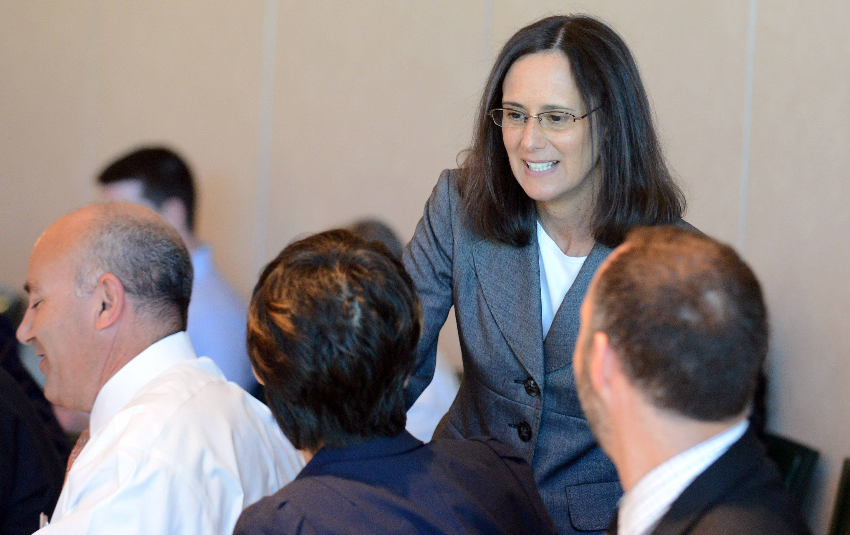 Illinois Attorney General Lisa Madigan greets those in attendance Wednesday the Centre of Elgin during discussion about how to identify and avoid major consumer scams.