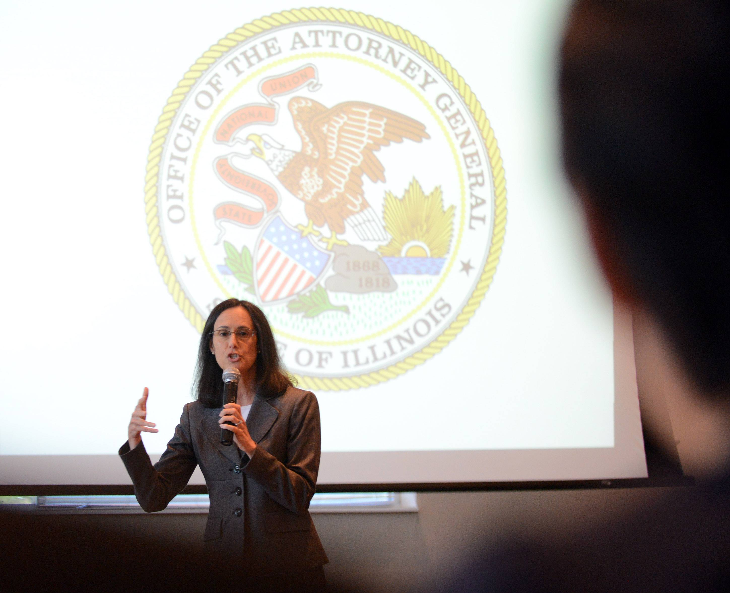 Illinois Attorney General Lisa Madigan speaks at a round-table discussion about how to identify and avoid major consumer scams, including identity theft and home repair fraud, as well as schemes that target seniors.