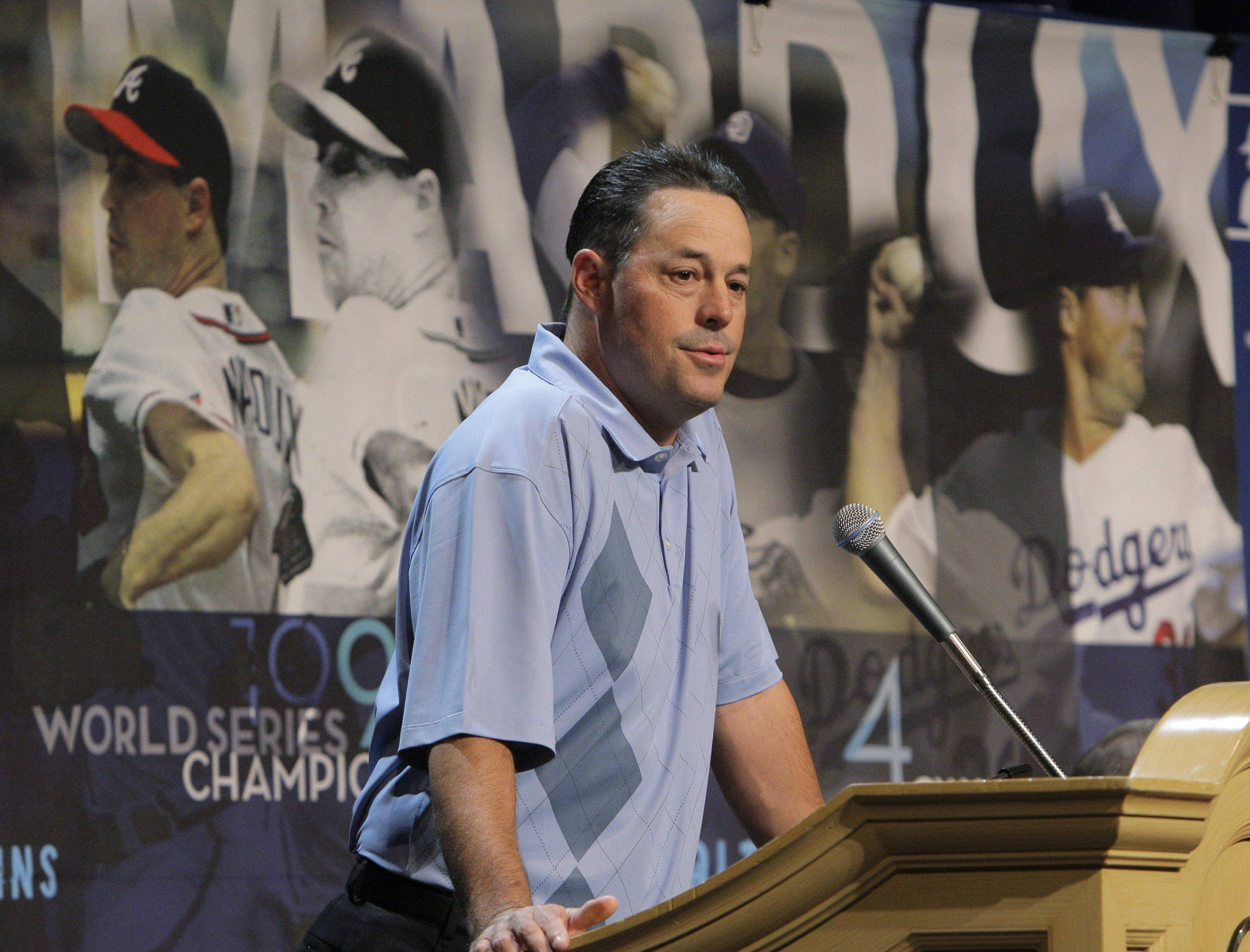 Four-time Cy Young winner Greg Maddux announces his retirement at the baseball winter meetings in Las Vegas, Monday, Dec. 8, 2008.