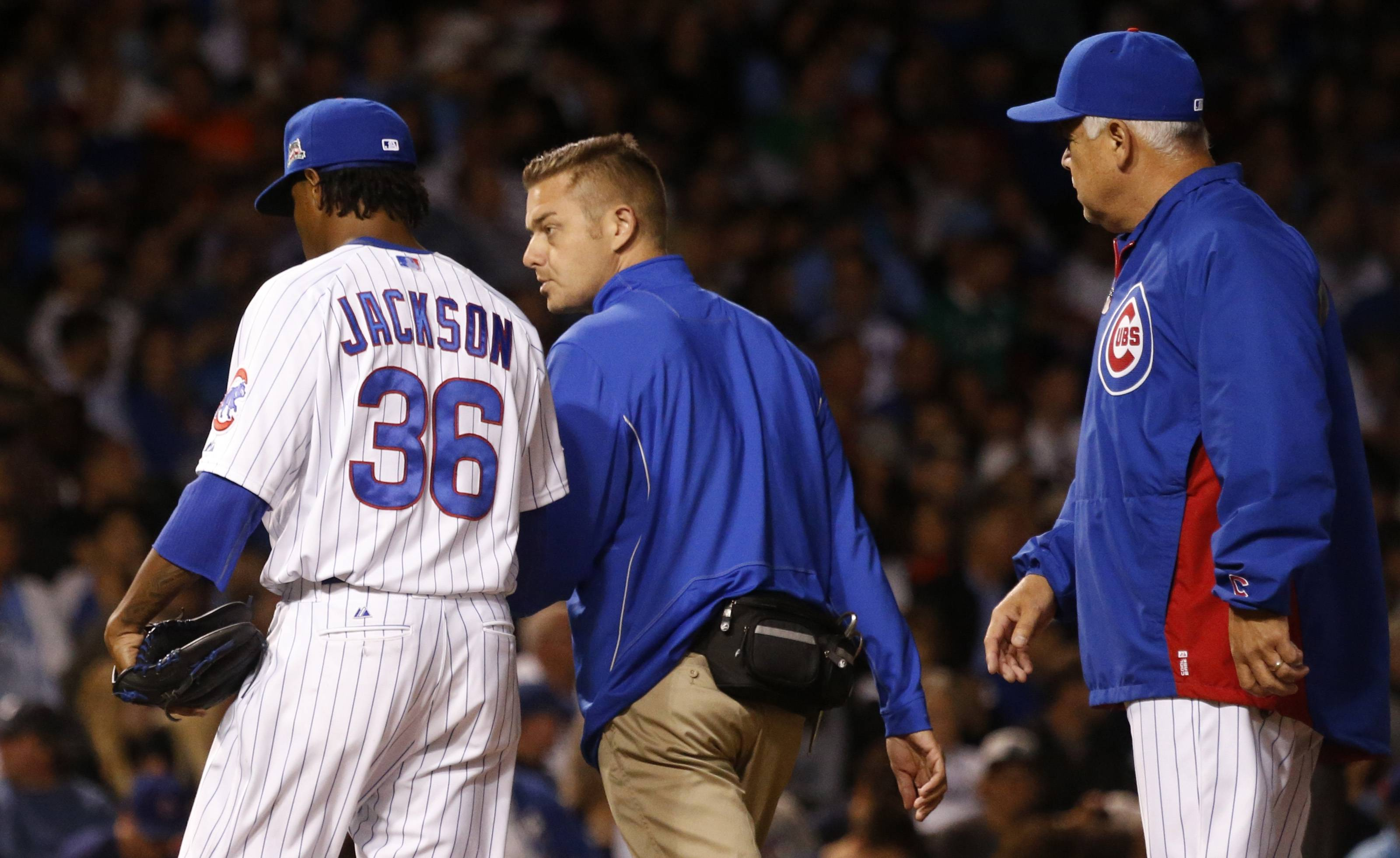 Cubs starting pitcher Edwin Jackson leaves a game as manager Rick Renteria, right, watches during the sixth inning Thursday night.